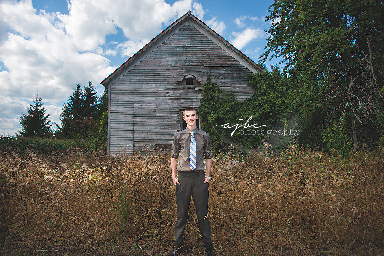 senior boy photoshoot in abandoned building port huron michigan senior photographer.jpg