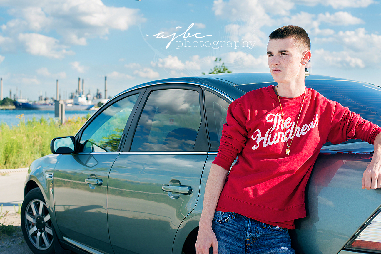 senior boy photoshoot with his car michigan senior photographer.jpg