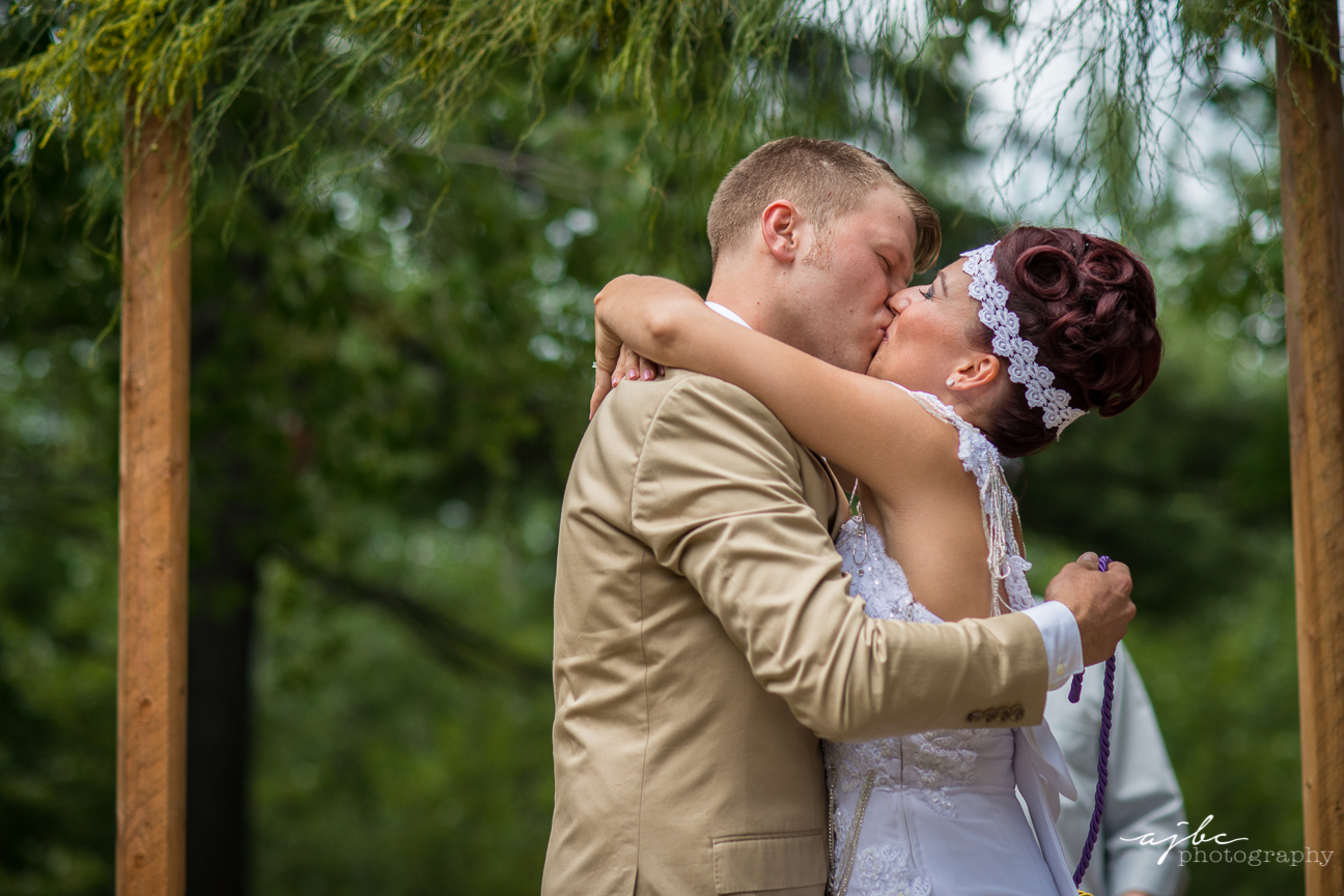 bride and groom first kiss.jpg