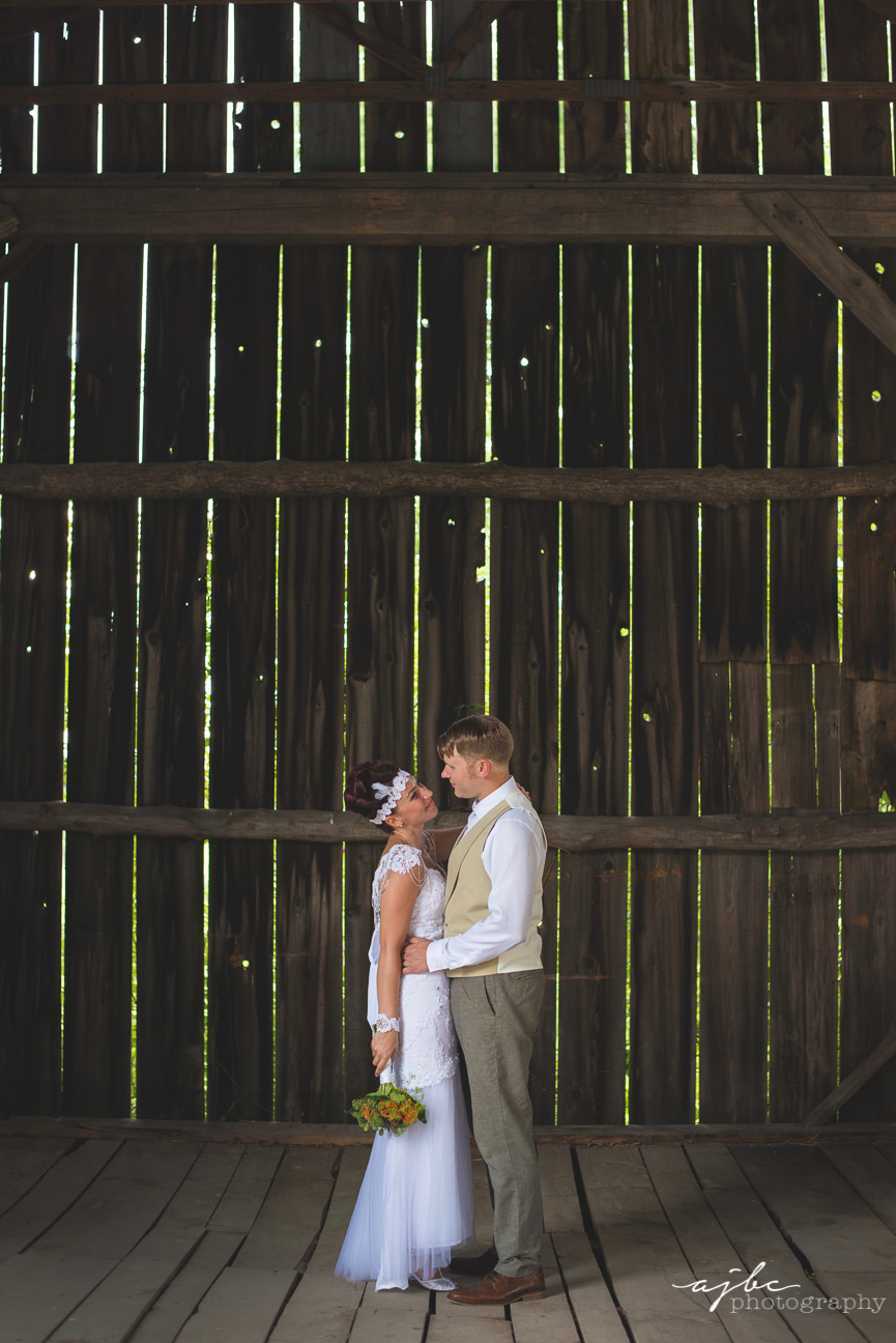 bride and groom in barn wedding photography michigan.jpg