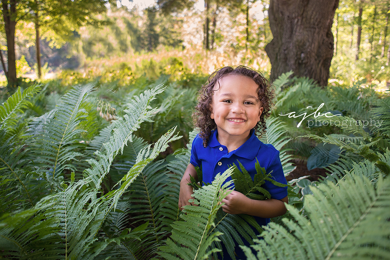 little boy in the woods outdoor family photographer port huron michigan.jpg