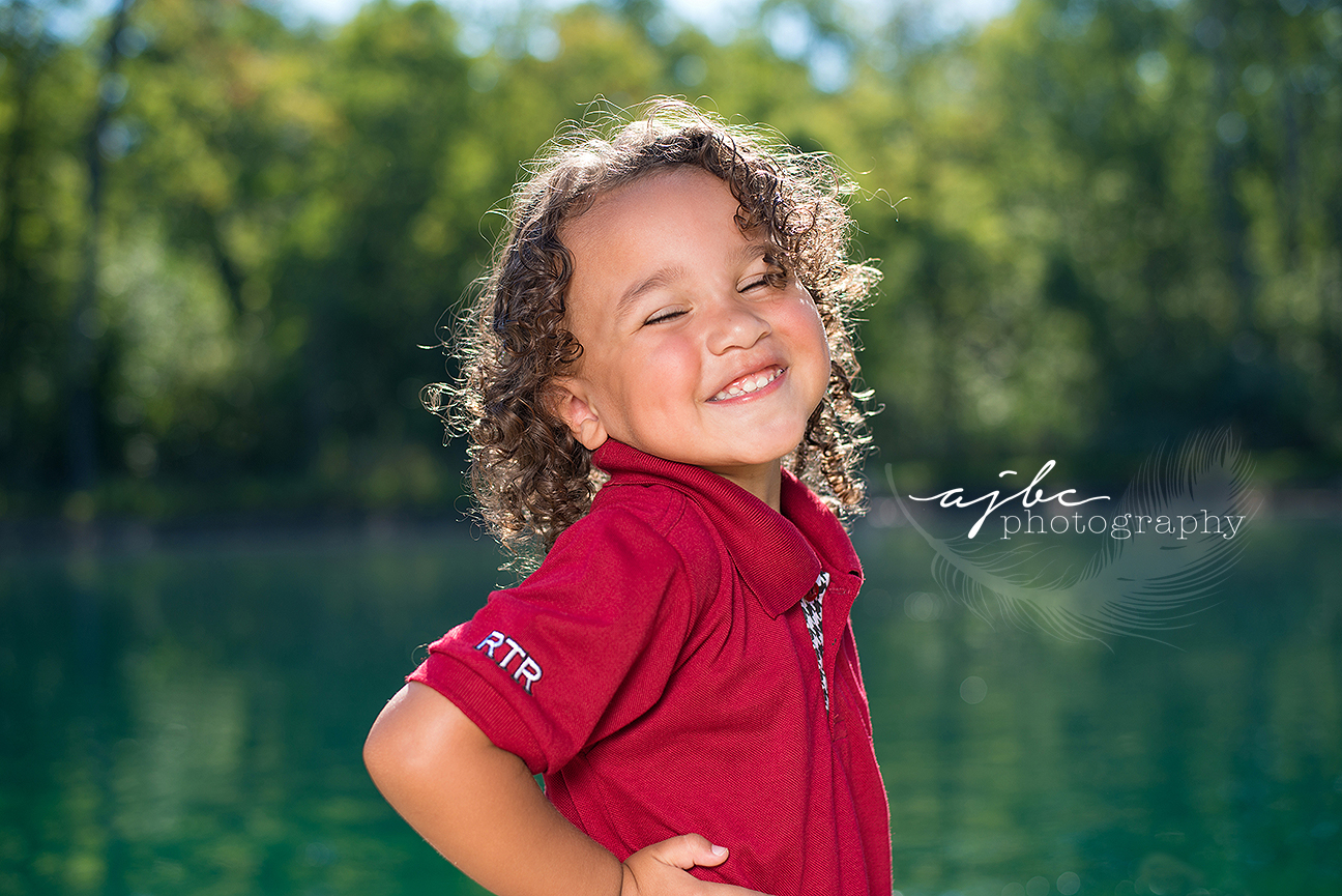 little boy in the water family love michigan family photographer.jpg