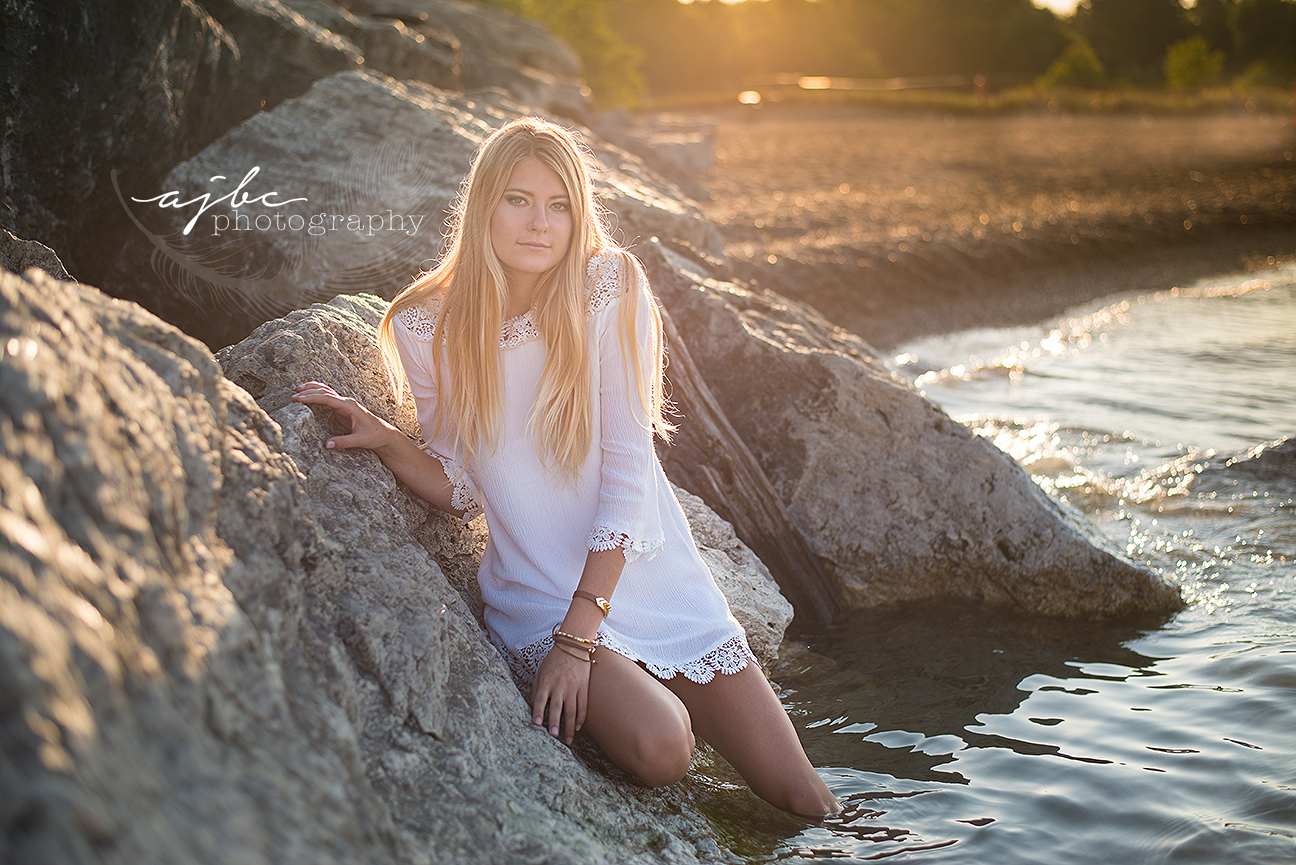 lexington michigan senior photographer beauty in the water splashing in the water senior girl on the beach.jpg
