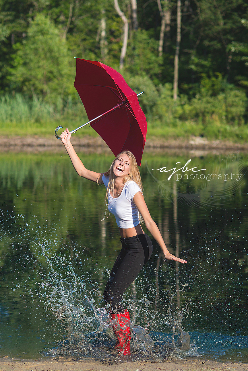 michigan senior photographer dancing in the rain photoshoot rain boots umbrella.jpg