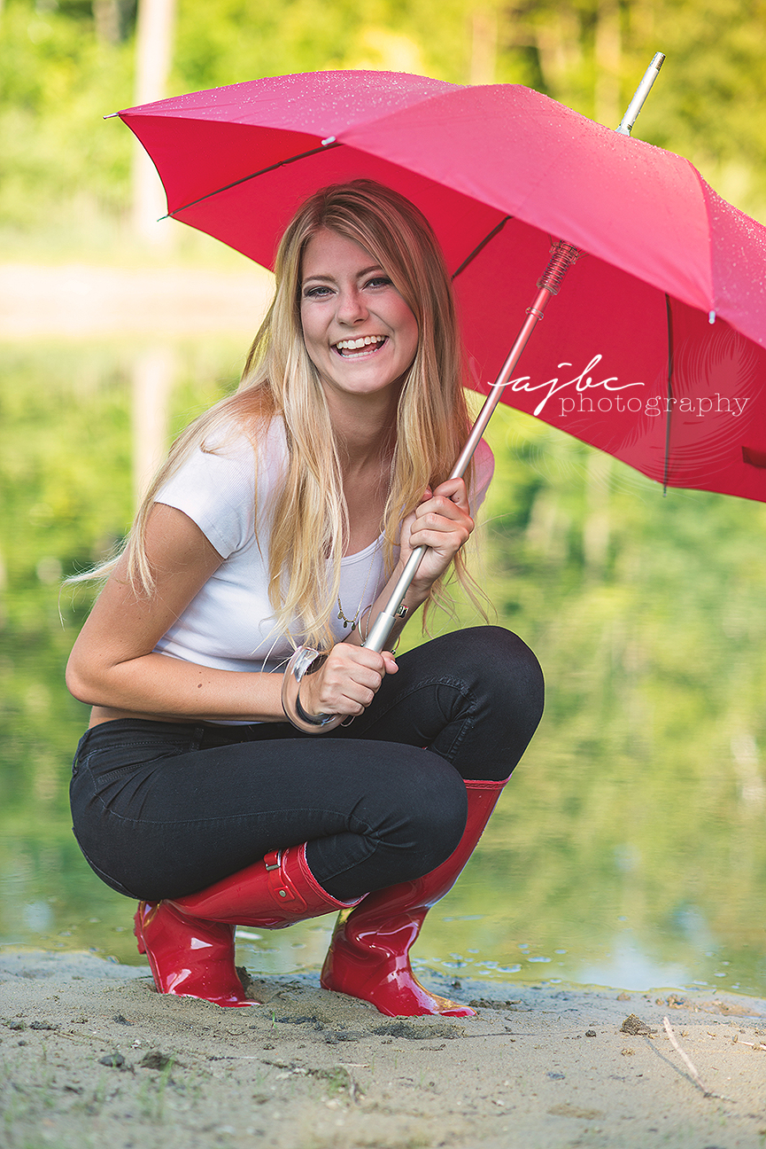 port huron michigan senior photographer outdoor senior photoshoot rain boots.jpg