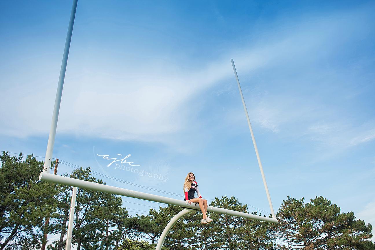 big reds cheerleader port huron high school senior football field michigan senior photographer.jpg
