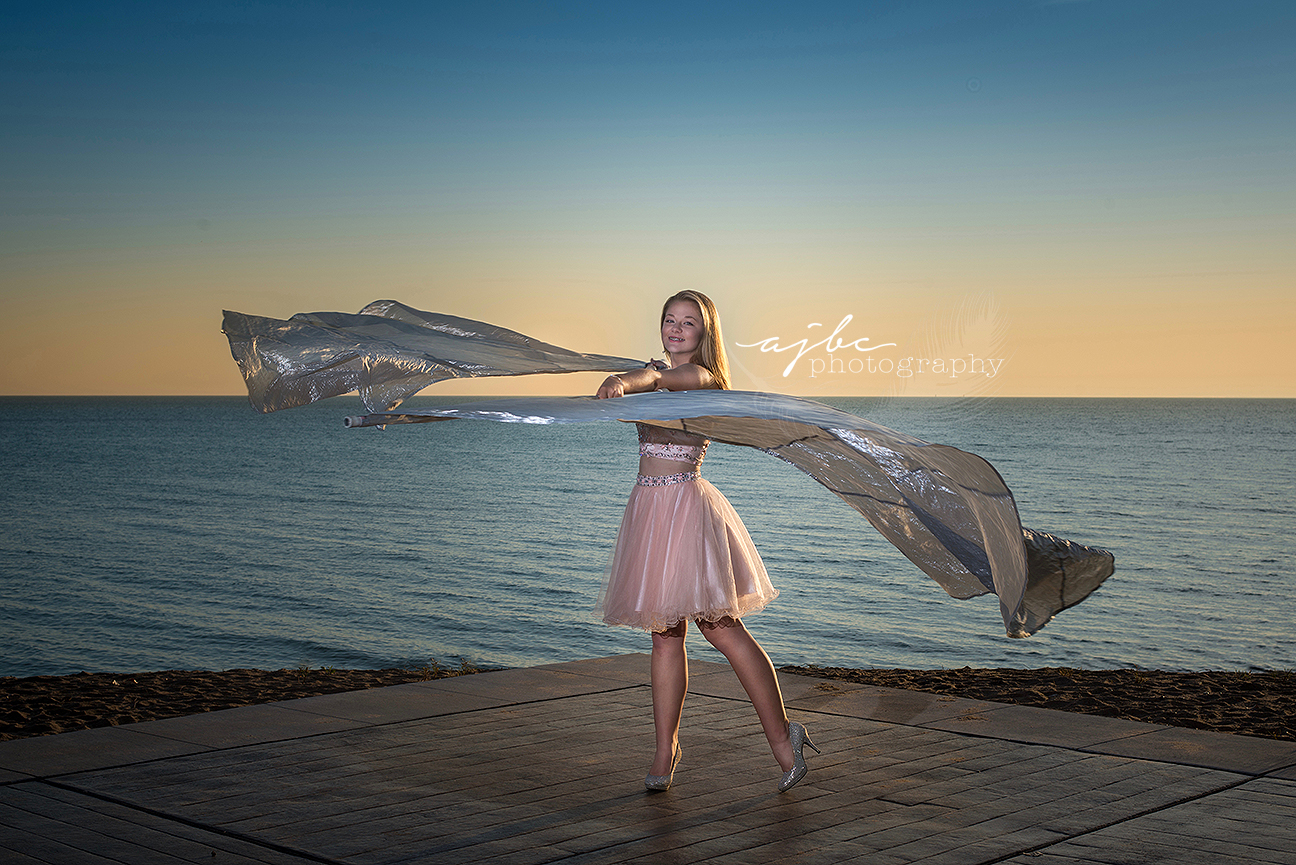 michigan senior beauty photographer port huron high school color gaurd senior in prom dress photoshoot on lakehuron.jpg