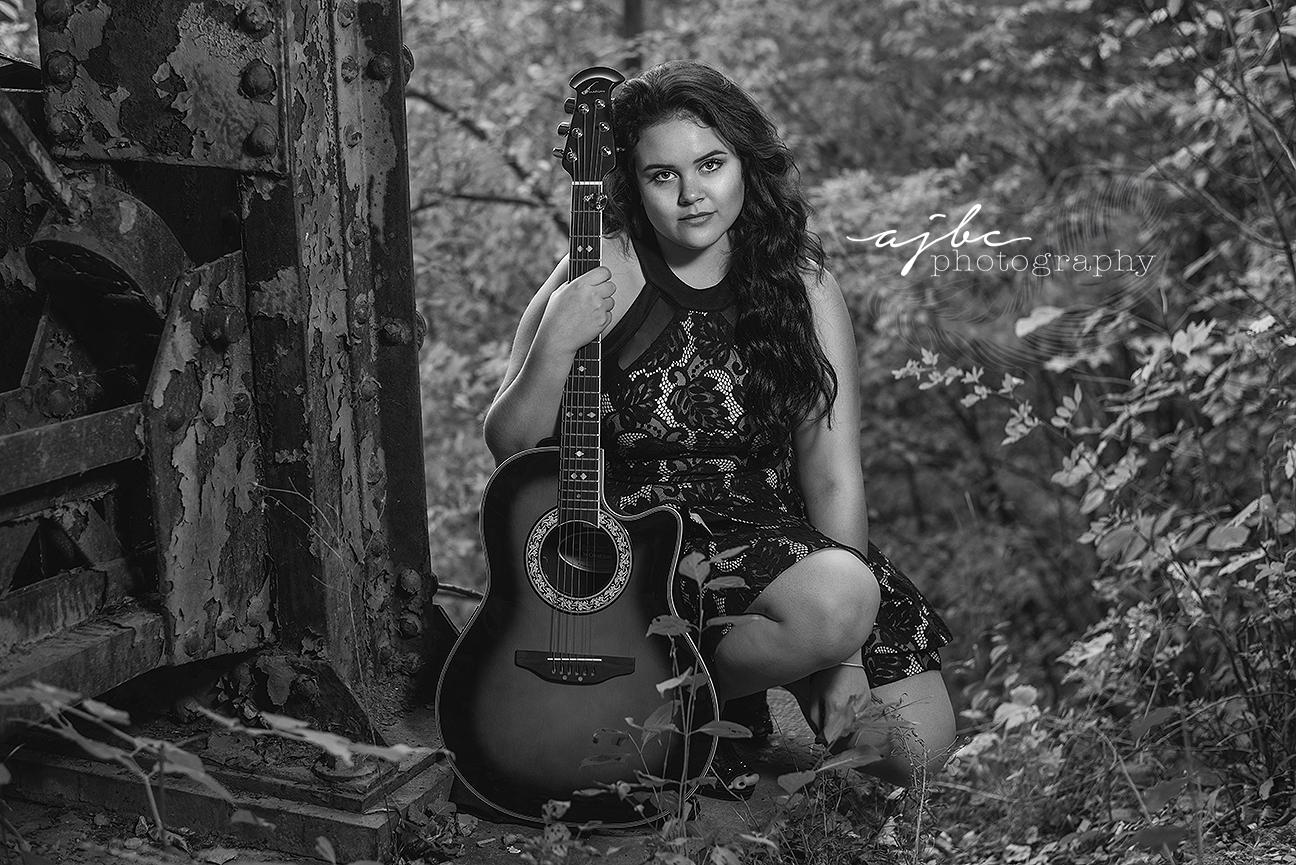 michigan high school senior photographer musician photoshoot girl with her guitar senior girl photoshoot sheet music creative high school photoshoot.jpg