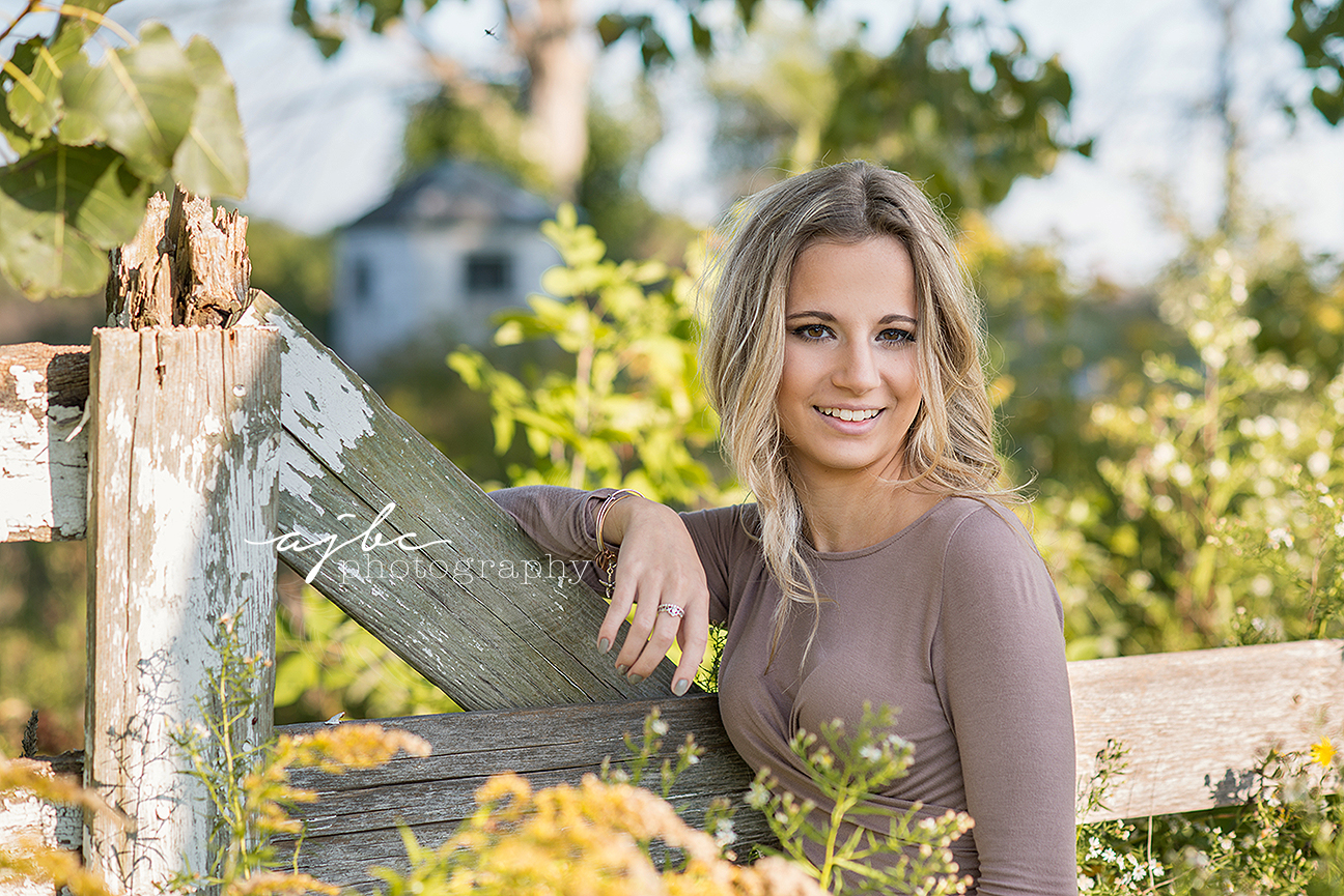 outdoor senior photoshoot country feel abandoned barns fall colors senior fashion senior beauty michigan senior photographer.jpg