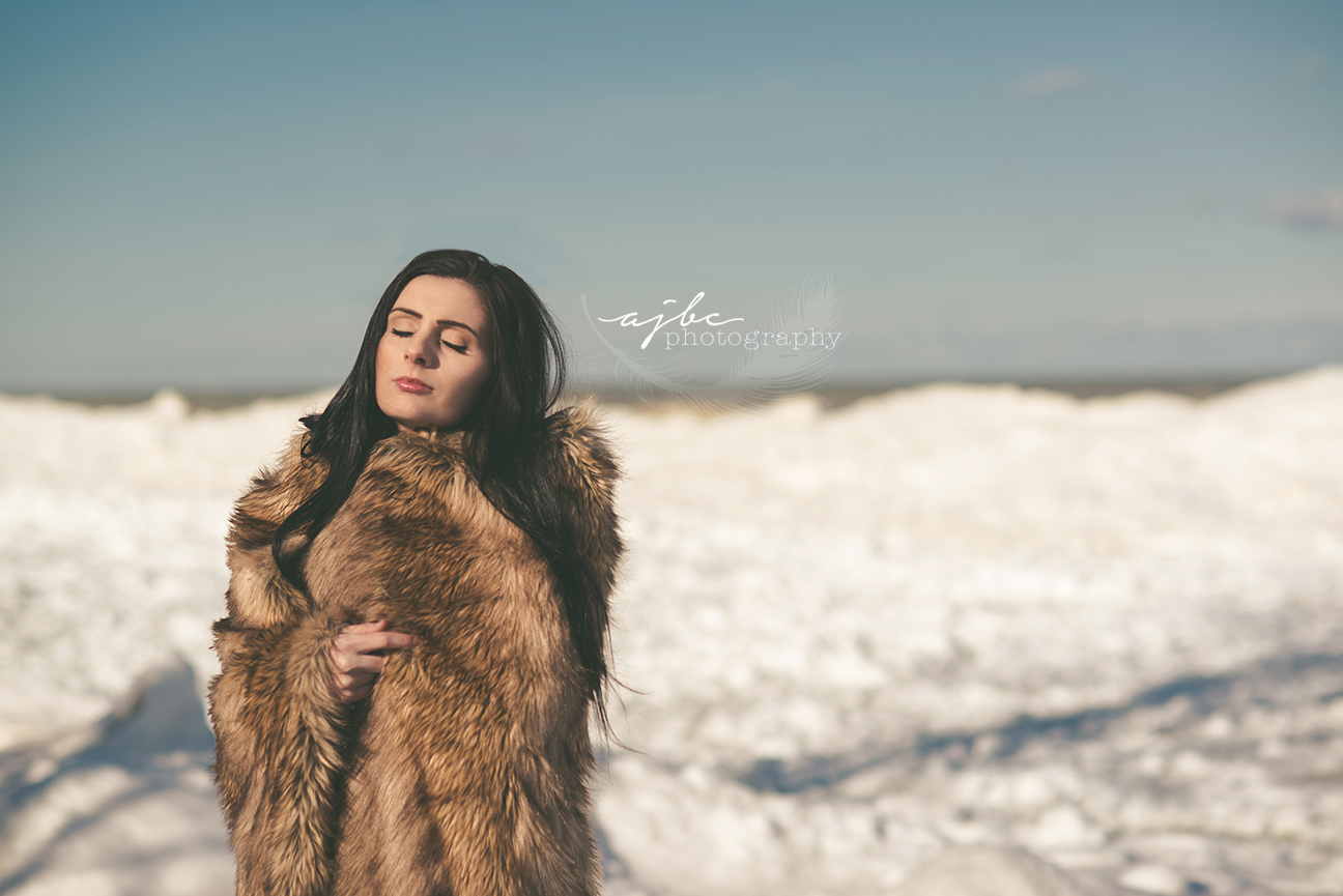 michigan winter photoshoot ice berg frozen shoreline photoshoot native woman photoshoot outdoor beauty winter beauty model.jpg