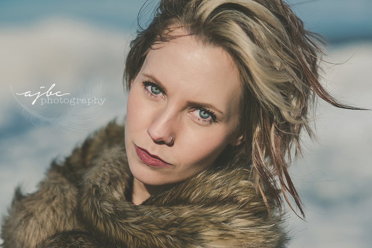 port huron michigan beauty photographer winter photoshoot lake huron frozen shoreline photoshoot ice bergs beauty portraits.jpg