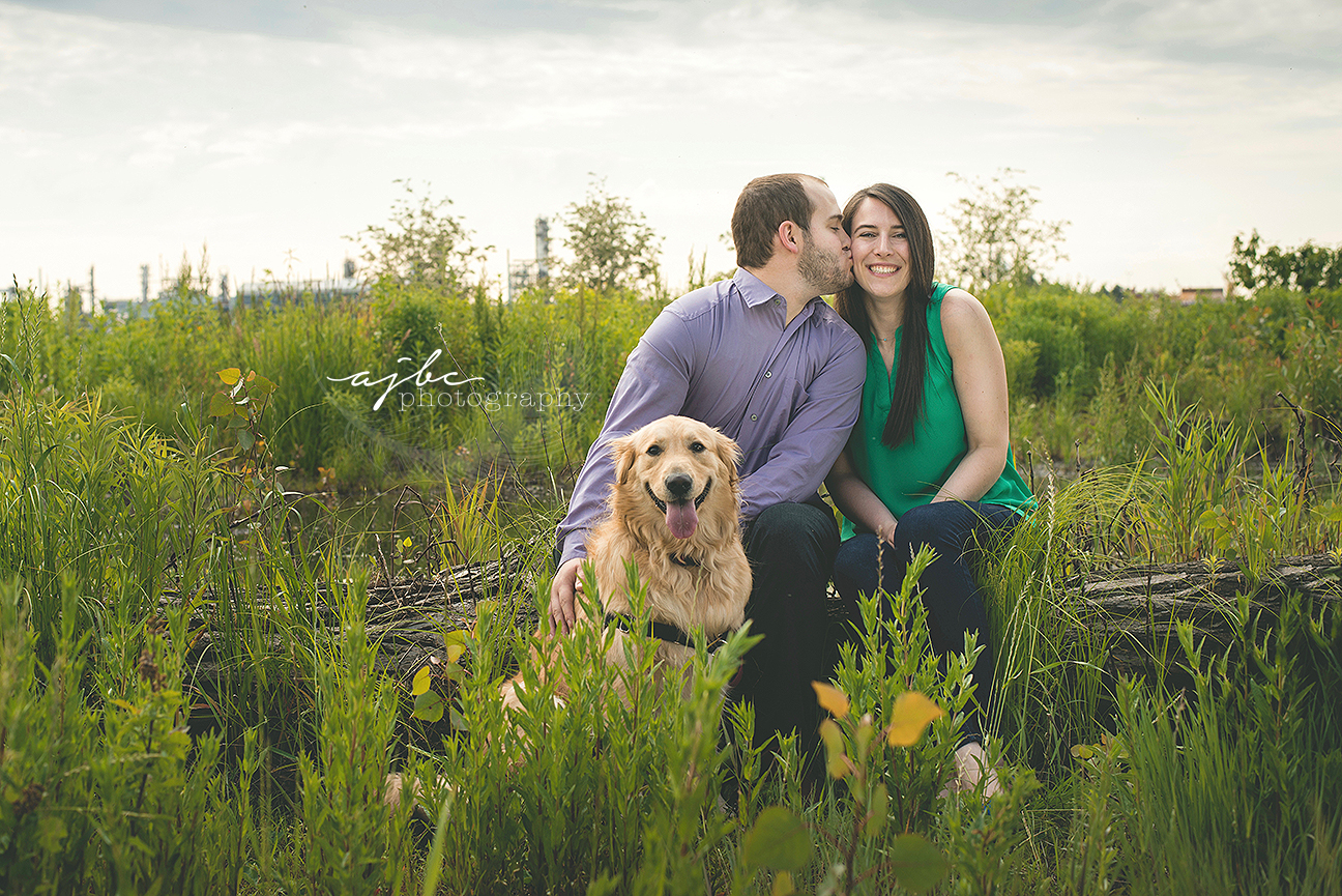 blue water river walk outdoor couple photoshoot engagement session with golden retriever.jpg