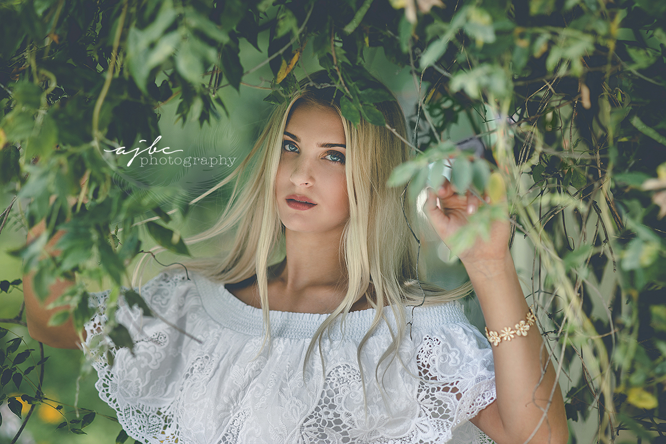 michigan outdoor senior beauty photographer white dress in the woods photoshoot.jpg