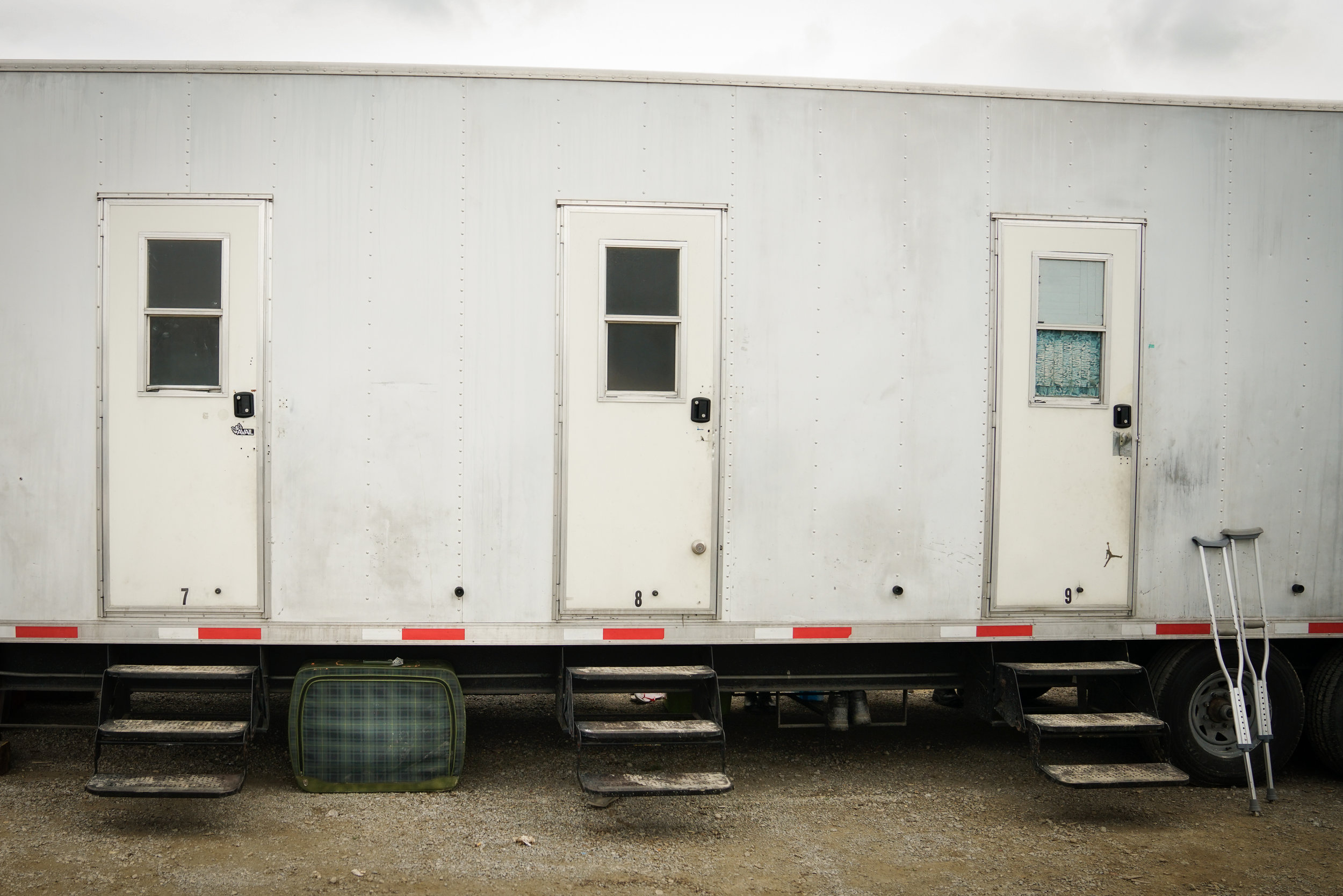 Trailer with Suitcase and Crutches