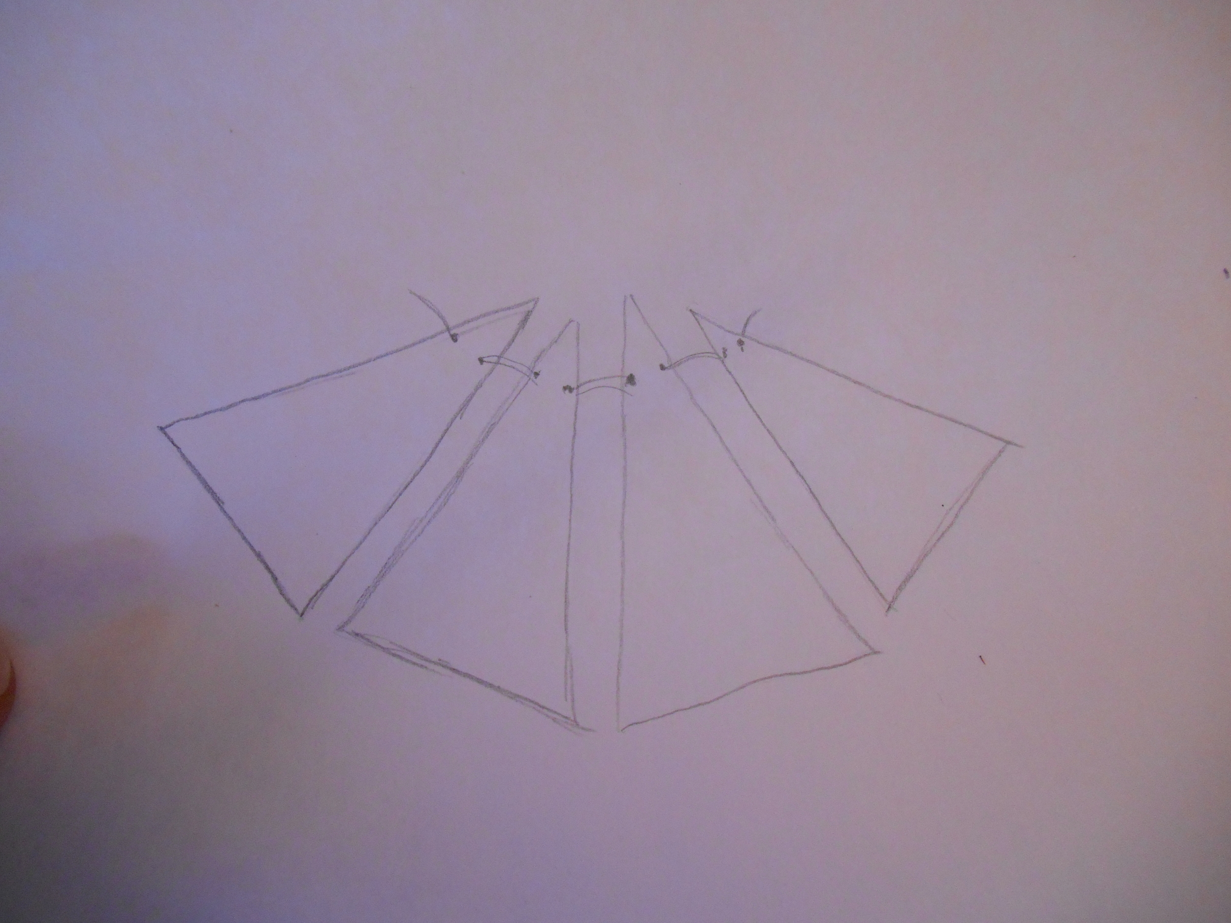 So it usually begins with an idea and some simple sketches (very simple). Right now I'm working on a geometric design neck piece. I decide on varying sized triangles. This particular design I am dreaming up as I go....