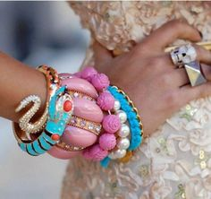 Great stacking trends going on right now!  Love the colors on these-though I'm not usually into pastels.  It looks like we are stacking all kinds of styles and metals with no looking back!    Source: www.fabfashionfix.com