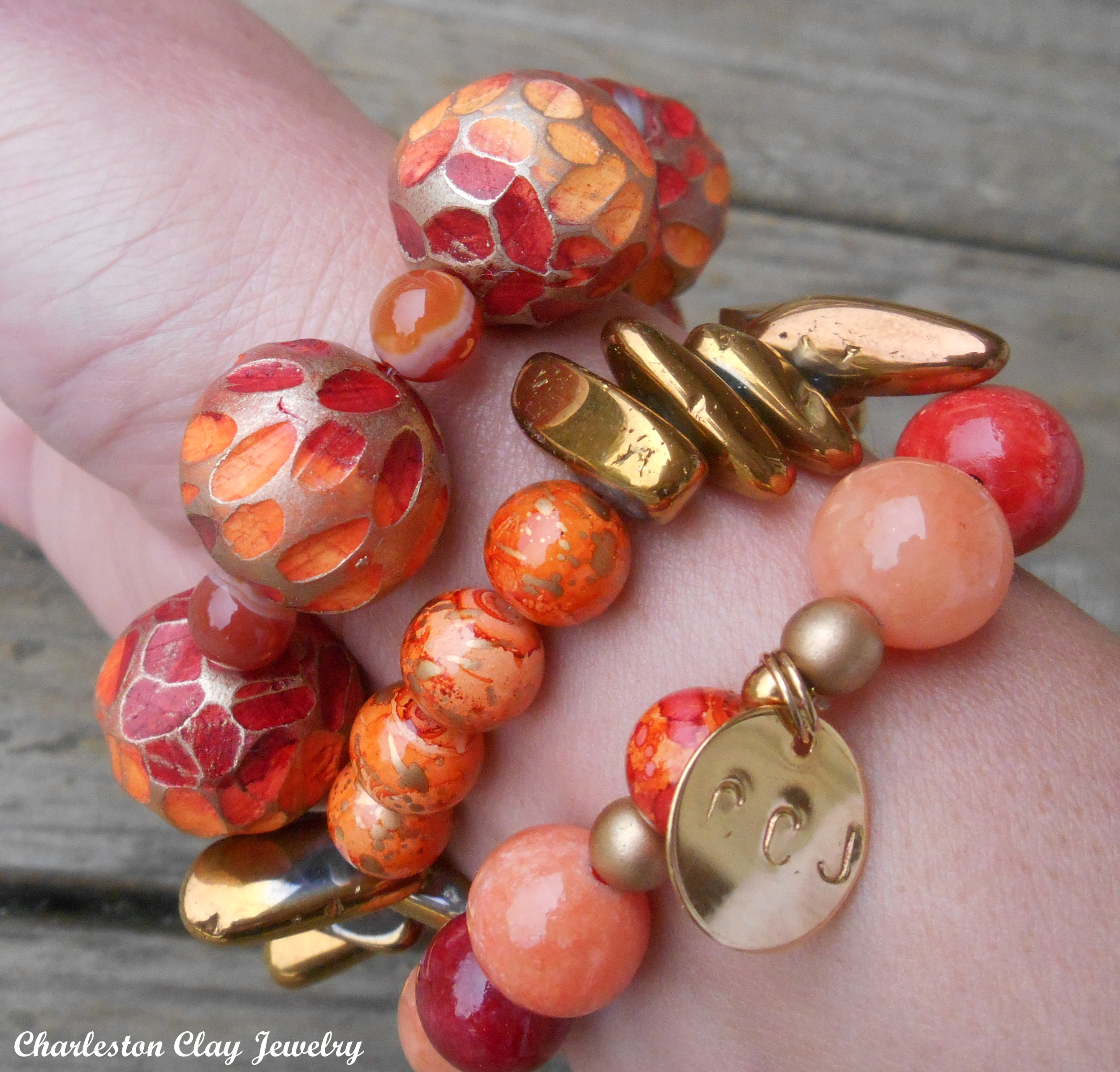 My own stacking bangles featuring my hand carved beads paired with crackled glass and golden spikes!