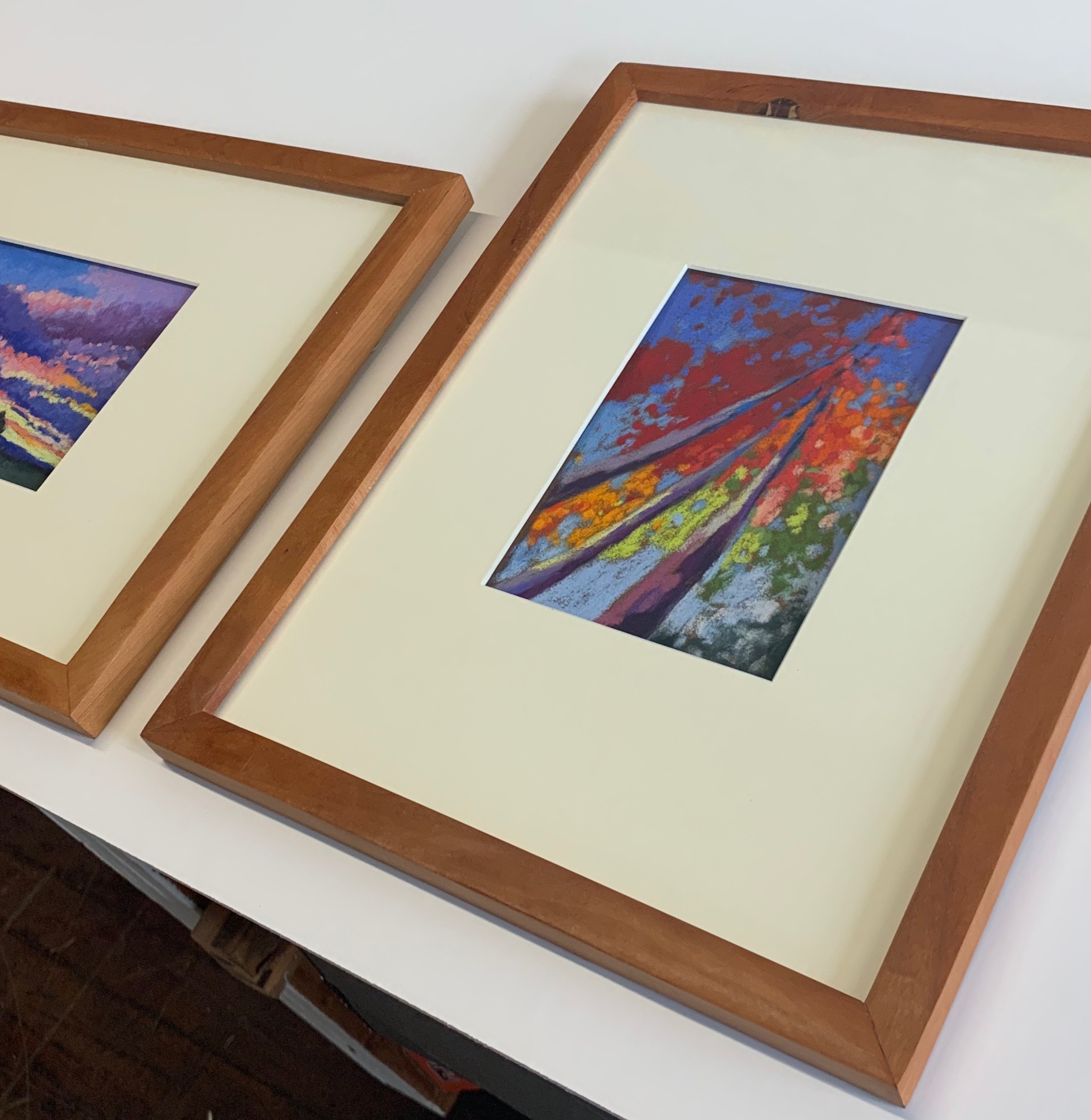 The smaller drawings are framed in thinner stock.
