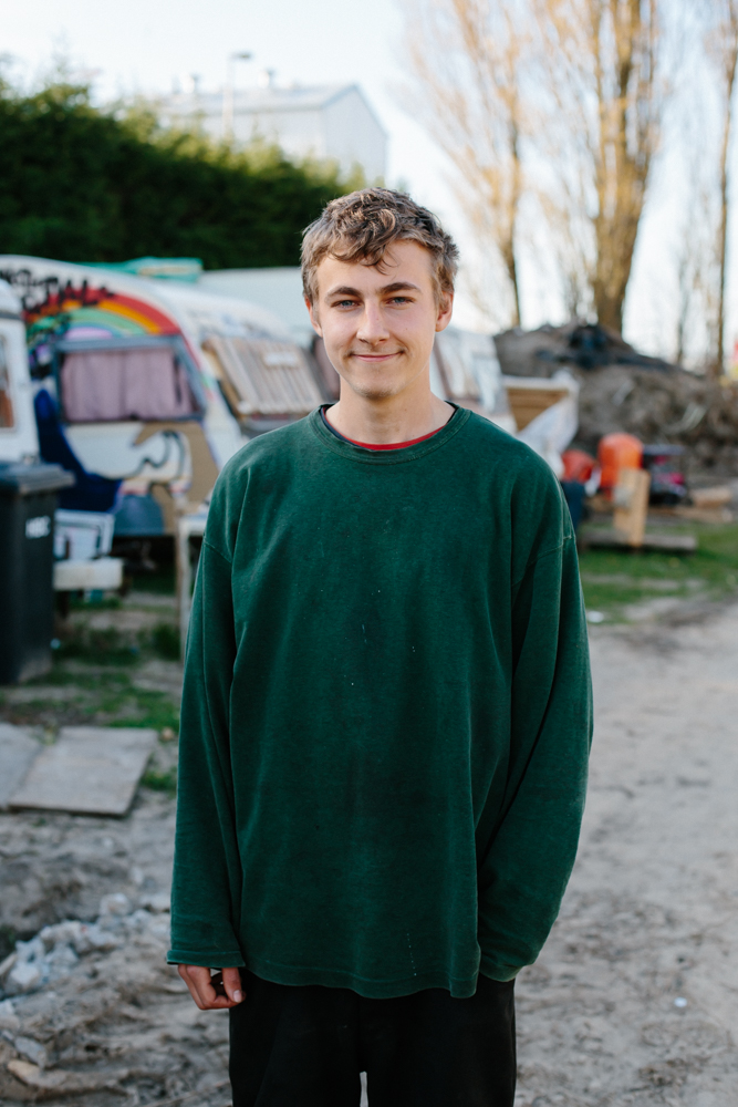 "Oscar, 21, Bristol    Volunteering in the Refugee Kitchens Calais for 7 weeks.  Initially food preparation then as part of the chef team.  He was living on site in a caravan provided by RKC.    ""Love is the only thing that really brings you here.  I feel a connection with everything and anything and when you see other people in a worse situation that yourselves you have a sort of feeling inside your body and that's what's drove me here to act. Love for other people and seeing other people in a difficult situation.    I've got time to help and I've got a good life so I can spend that doing things that entertain me or doing things that satisfy me or i can spend that time helping others. And whilst having fun is good, I think that helping others is something way more valuable than anything else I've ever experienced.    One of the main things I've realised how useful I can be.  We spend so much time just doing stuff that isn't really useful, just doing stuff for ourselves and spend so much time thinking and worrying but when you are in a   situation when things need to be done you can, no matter who you are or what experiences you've had, put yourself to work and you can be really useful and you can really make a difference.  I've never had any experience in a kitchen and then there was a time when I was running it just because of the necessity of it.  But the necessity seems to bring out this power inside you.  And now I've seen that in me it's given me motivation to do more of that.    I've learnt way more here than any school or university.  There is something about doing stuff like this; you learn so much about the world, about yourself.    [I want to] spread the world to people and continue bringing positivity into the world and help motivate other people to be useful as well and actively want to make a difference in the world. There are so many problems in the world it's all down to how we live our own lives.  Offering people a different way of living.  A way that they can help and they can change the world""."