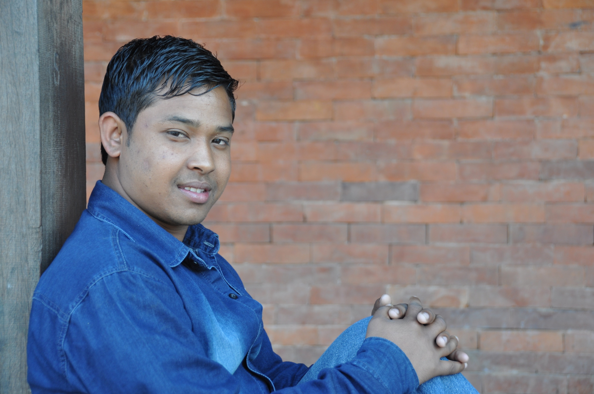 Raj    Raj is Nabin's older brother.  His dad died when he was very young and his stepfather was an alcoholic who beat the boys.  He ran away from home and got on a bus to Bhaktapur when he was eight years old.  He lived on the streets with other boys and would sneak into weddings and birthday parties to steal food. David found the two brothers playing in a temple and asked them if they wanted a place to stay, food, and to go to school.  Raj ended up going the the children's home with David that day; he was ten years old.  He said that giving up the glue sniffing was easy, but not being able to come and go as he pleased was the hard part.  He eventually settled down and was able to attend school.  Raj plays bass guitar and helps with the music in church.  He graduated from school in 2013 and is studying the tourism industry in college.