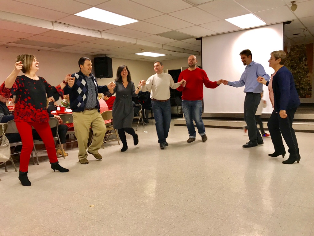 Albanian friends sharing a meal and dancing at a recent Christmas party outreach
