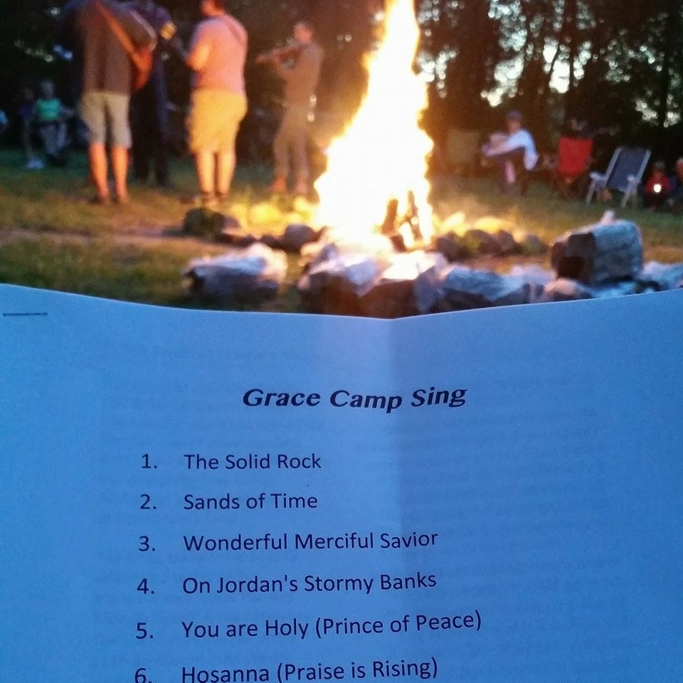A highlight of the annual Grace camping trip is singing around the campfire.