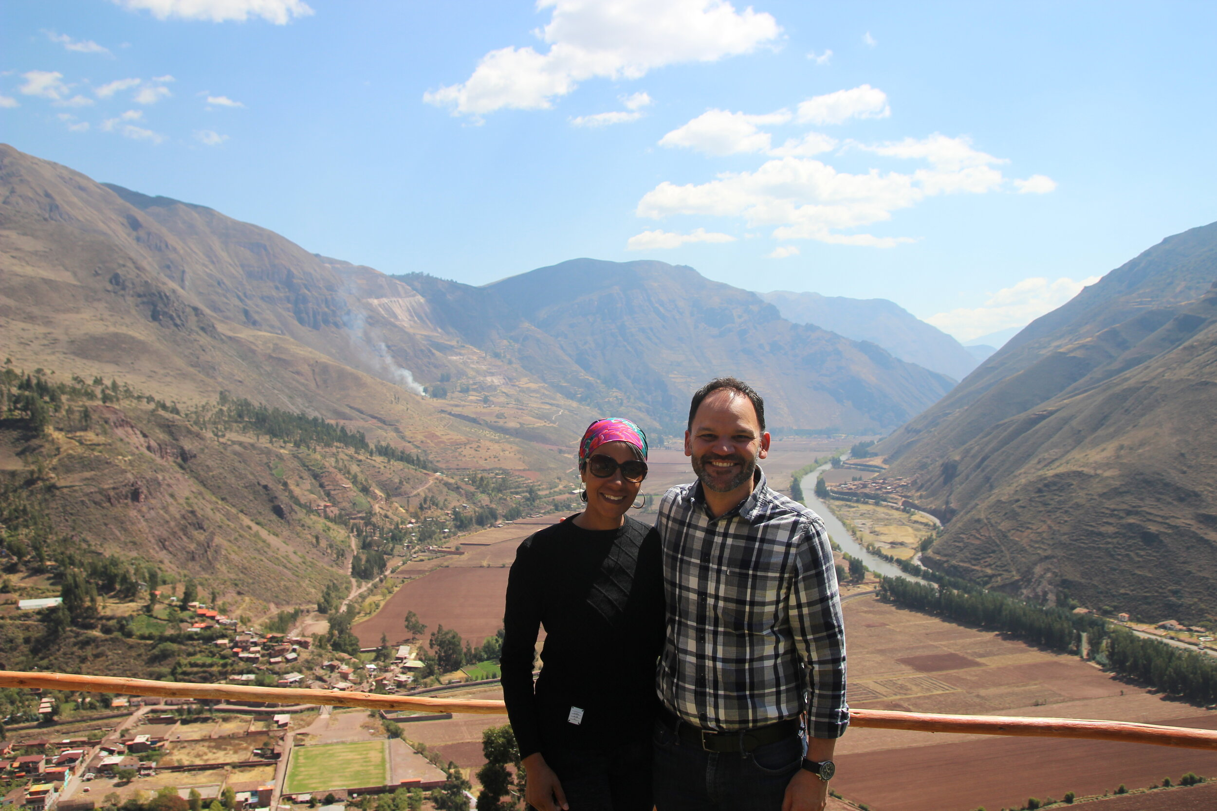 """Alison and Omar standing in front of the """"Sacred Valley of the Incas"""""""