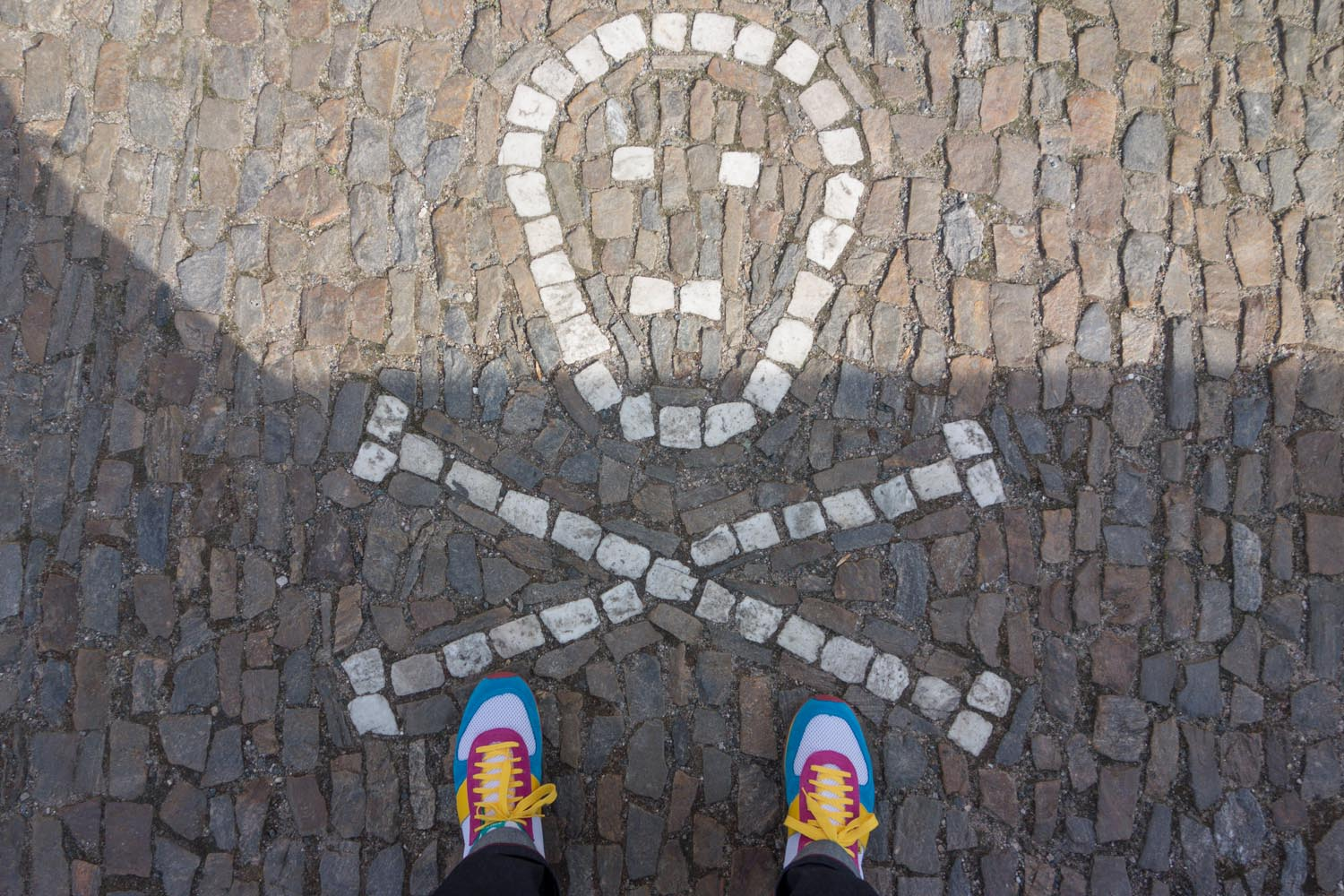 Jan's Botas sneakers in front of the Ossuary in Sedlec, Kutna Hora.