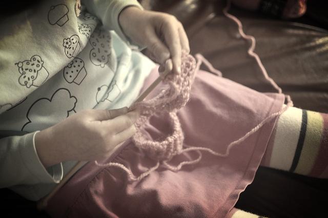 A child knitting
