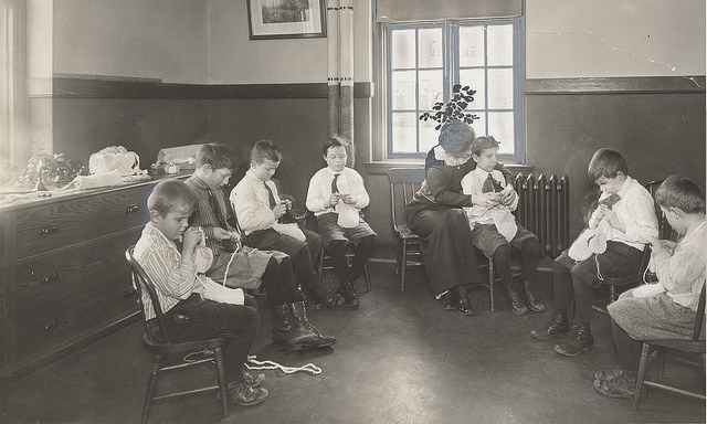 Children learning to knit