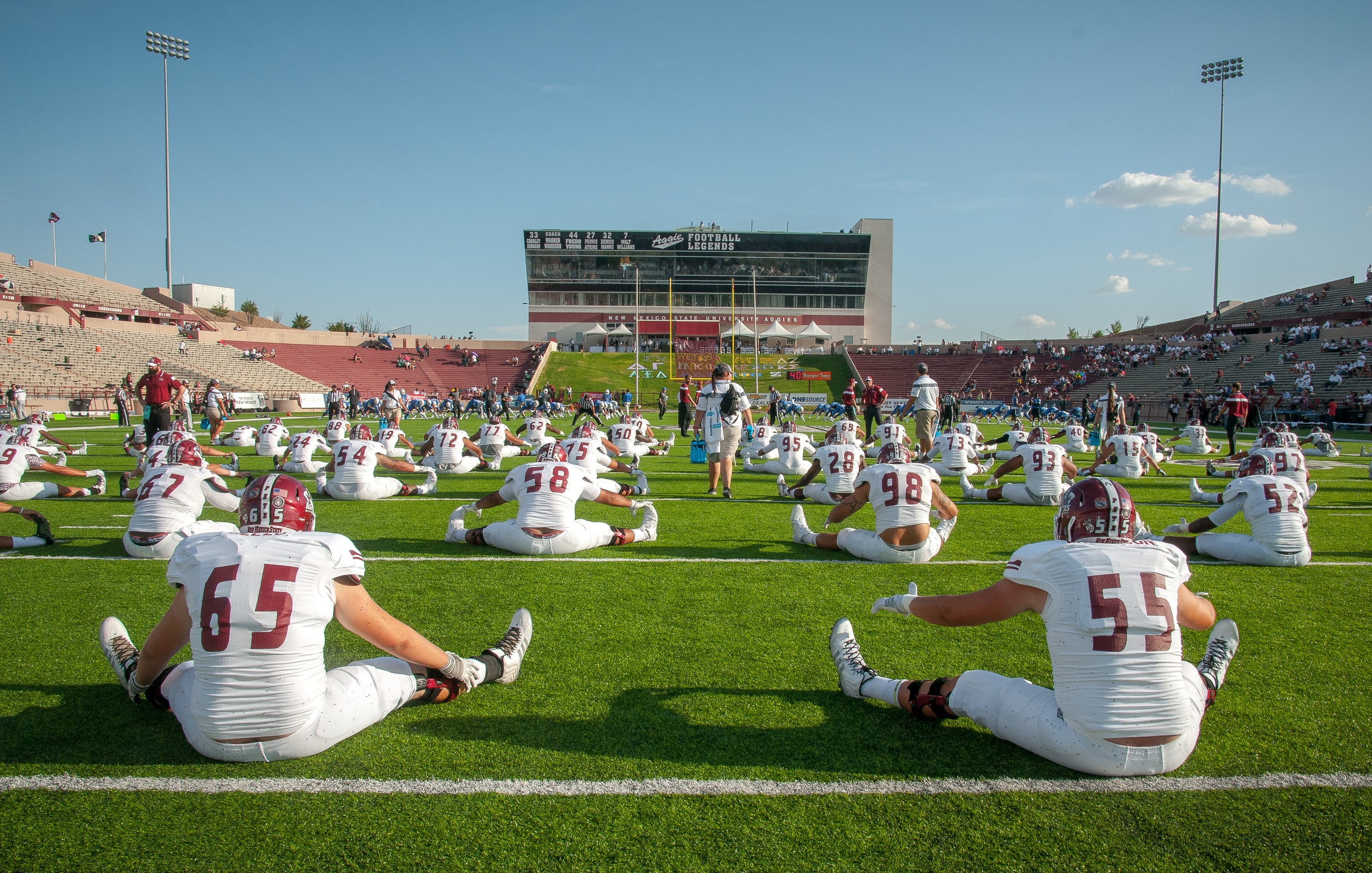 NMSU football players warm up on the field at Aggie Memorial Stadium before the start of the Aggies versus Georgia State Panthers game.