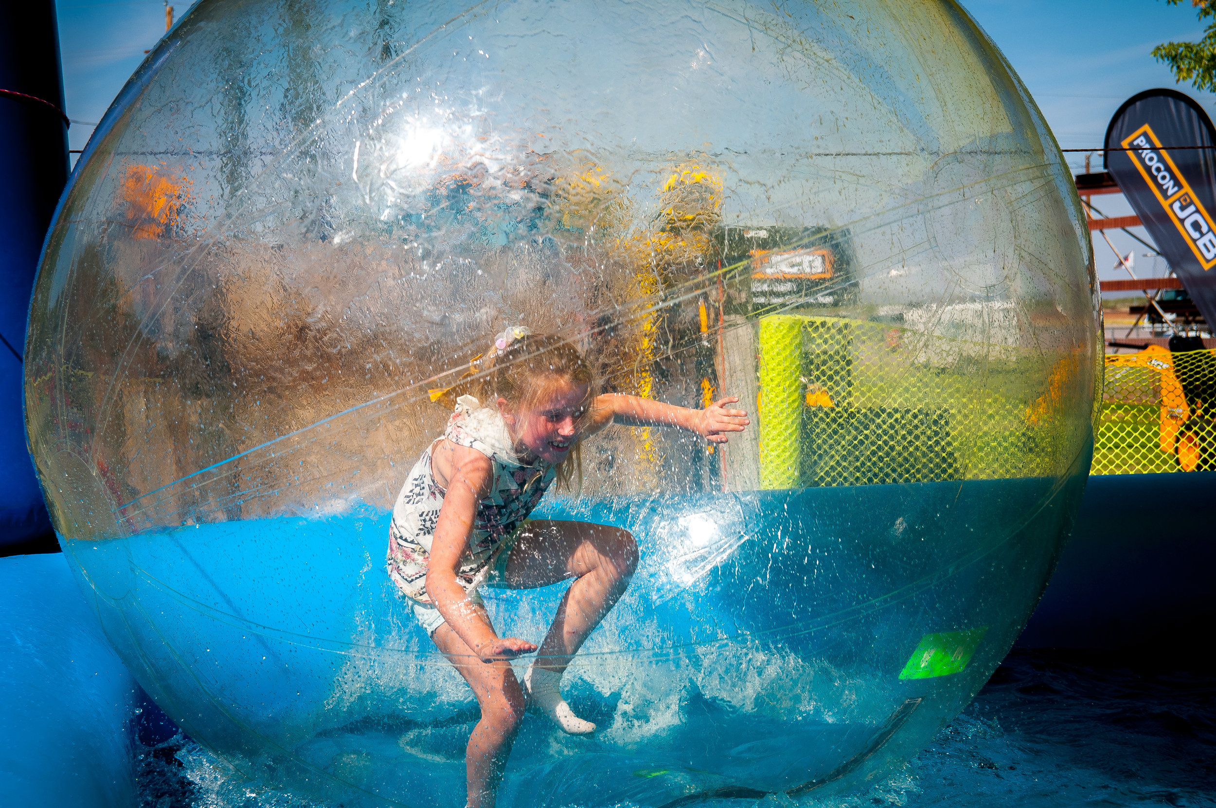 6-year-old Rankin Giraud enjoys herself while rolling in the water at the 'Wow Bubbles' attraction at the 2015 Southern New Mexico State Fair & Rodeo.