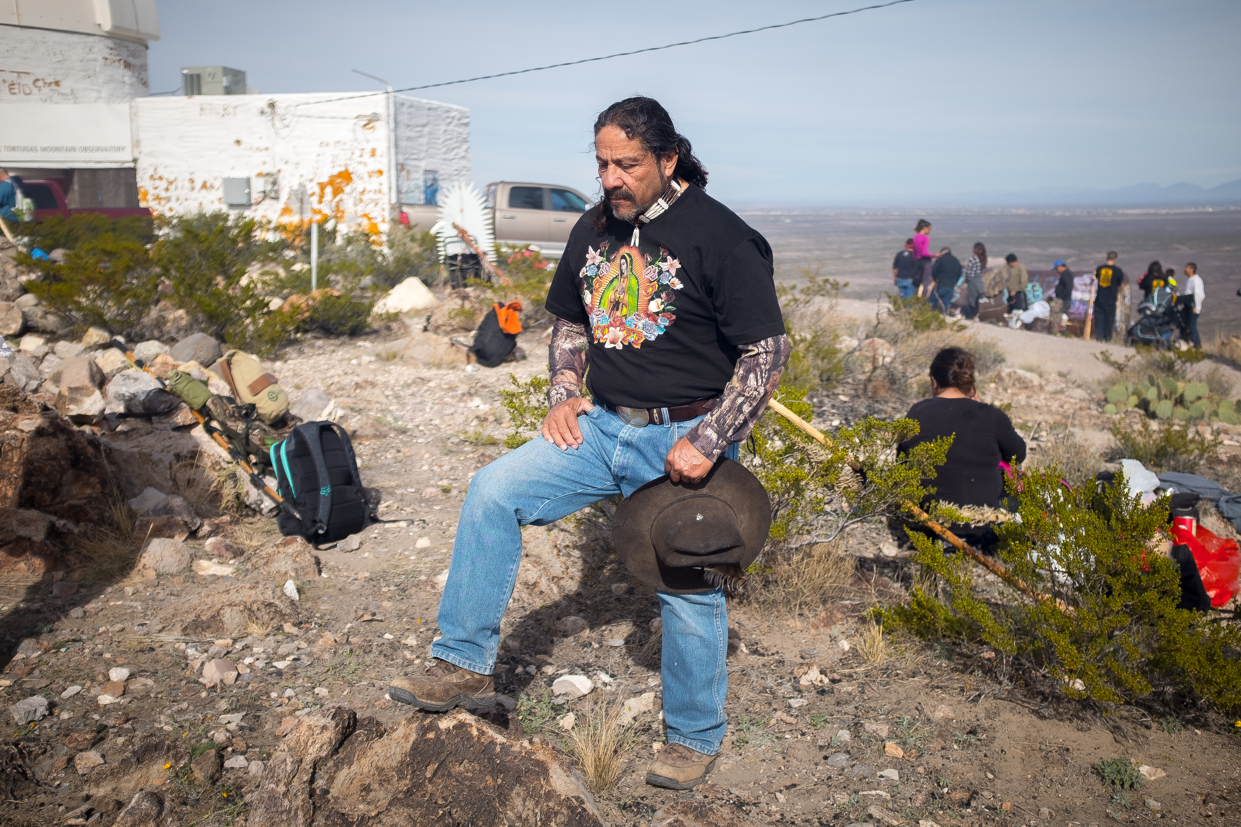"Joe Franco listens to Bishop Oscar Cantú performing the Catholic Mass on the top of Tortugas ""A"" Mountain on Friday morning. Franco has made the pilgrimage up the mountain for 18 years as part of Tortugas Pueblo's three day Our Lady of Guadalupe Fiesta."