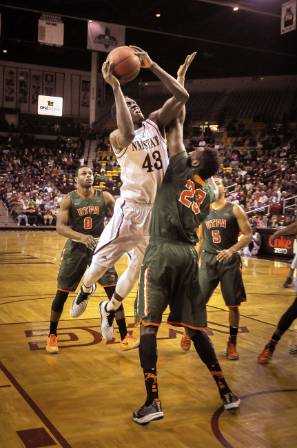 New Mexico State University's  Pascal Siakam powers over a rival at the Pan American Center, Las Cruces, NM.