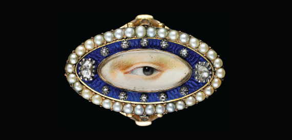 A blue enameled, diamond, and pearl ring, with a painted lovers eye on ivory in the center, c. 1790. 3/4 x 1-1/4 x 7/8 inches