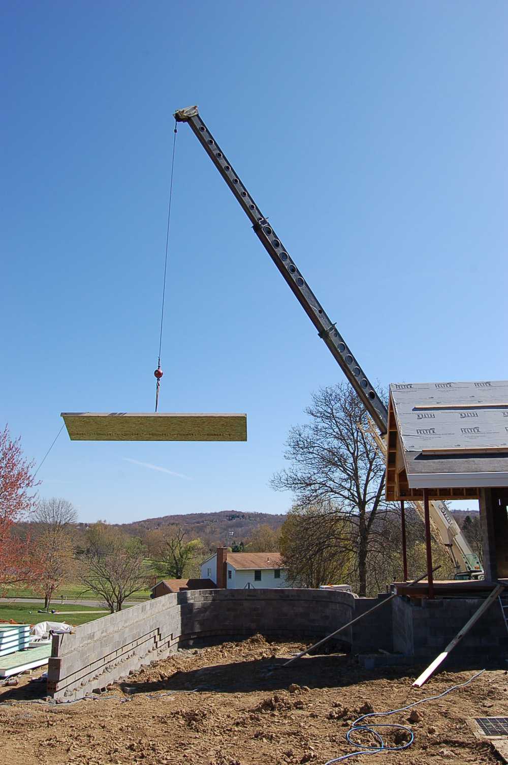 SIP panel gets lifted into place on the church roof at North Sewickley Presbyterian Church.