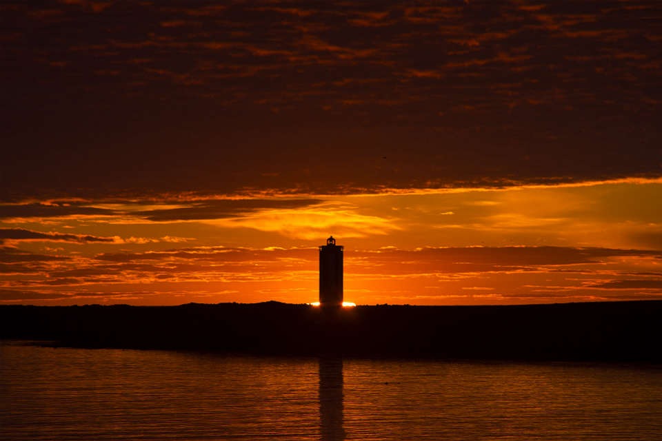 Hraunhafnartangaviti, the northernmost lighthouse on the northernmost peninsula of the country, sits in front of the sunrise at two am, just two hours after the sunset. During the summer, Iceland has no darkness.