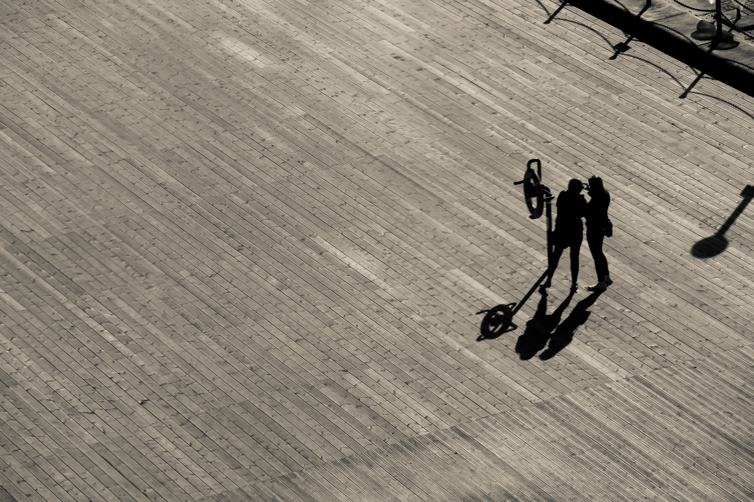 A Selfie Together  Let's see: an awesome wooden texture, amazing light, people interacting naturally (and quite narcissistically) and of course, me being a sucker for a silhouette? This picture makes the cut.