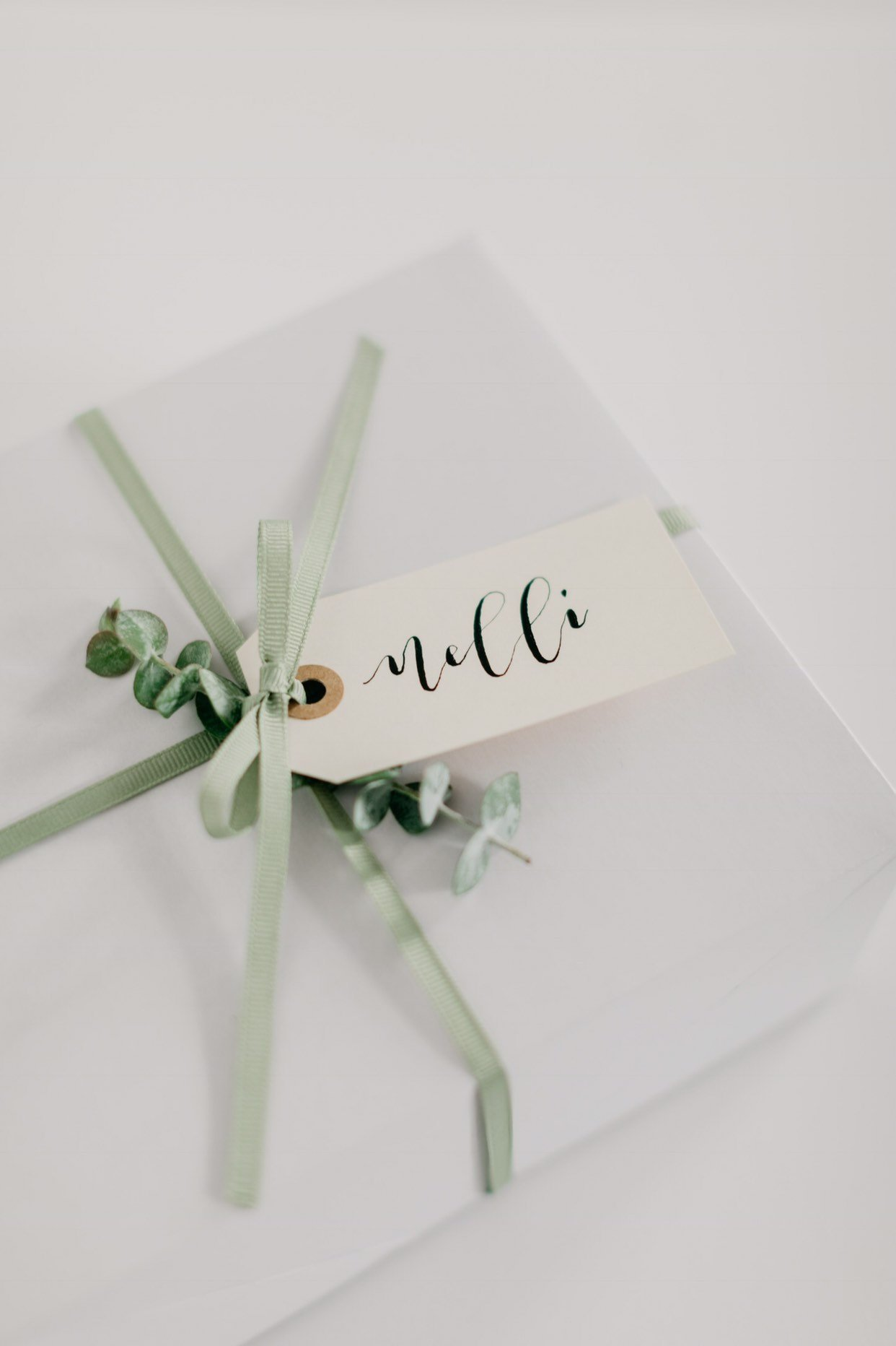 Flourishes by Fran - When you're wrapping Holiday presents at home, these custom calligraphy gift tags by Frances Chae of Sacramento Ballet. will give your presents just the personal touch they need.