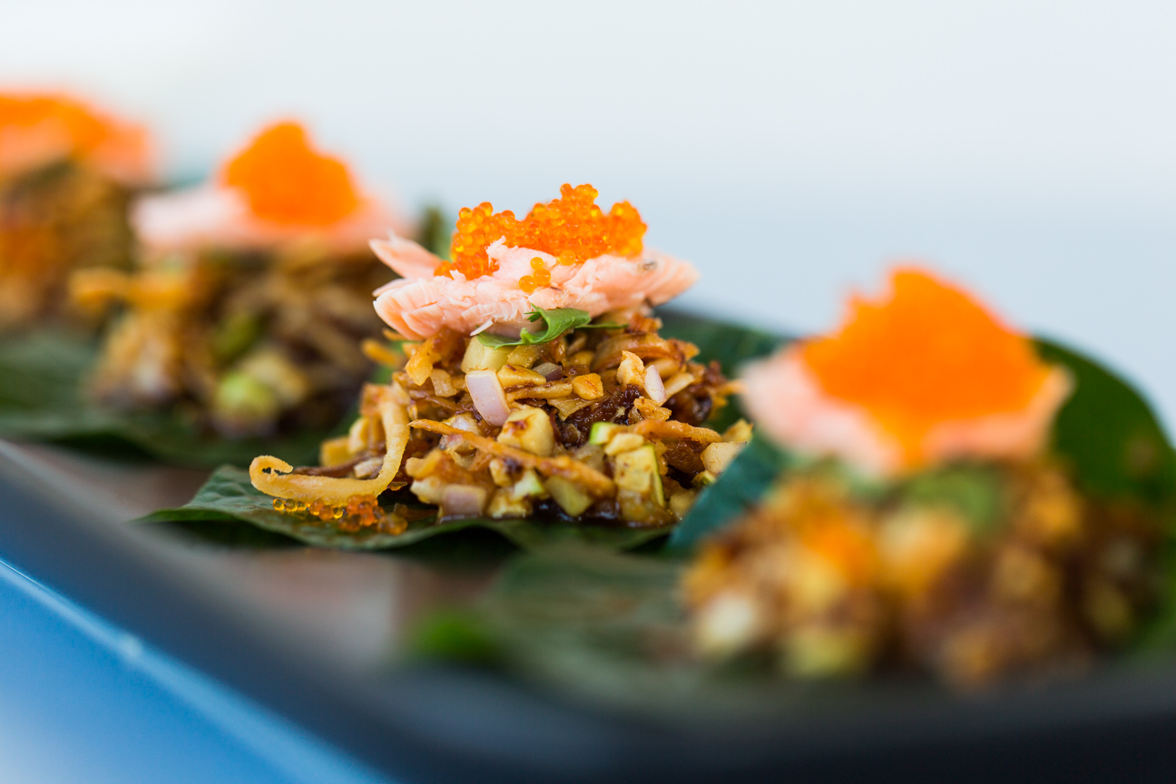 Betel Leaf with smoked trout, ginger, lime, roasted coconut and caramelized palm sugar