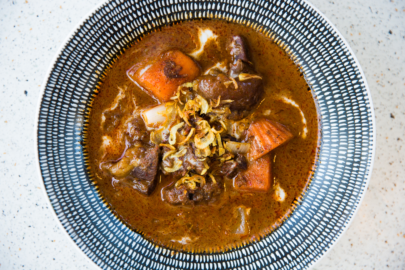 Braised ox cheek massaman curry with sweet potatoes and onion