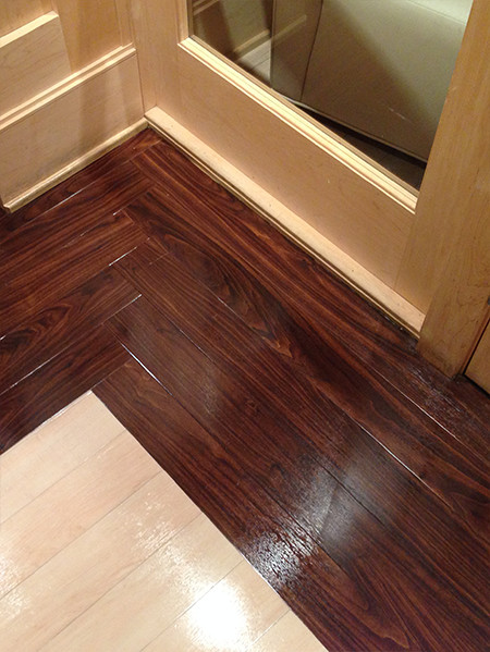 A close of photo of shiny flooring after it has been cleaned and re-finished.