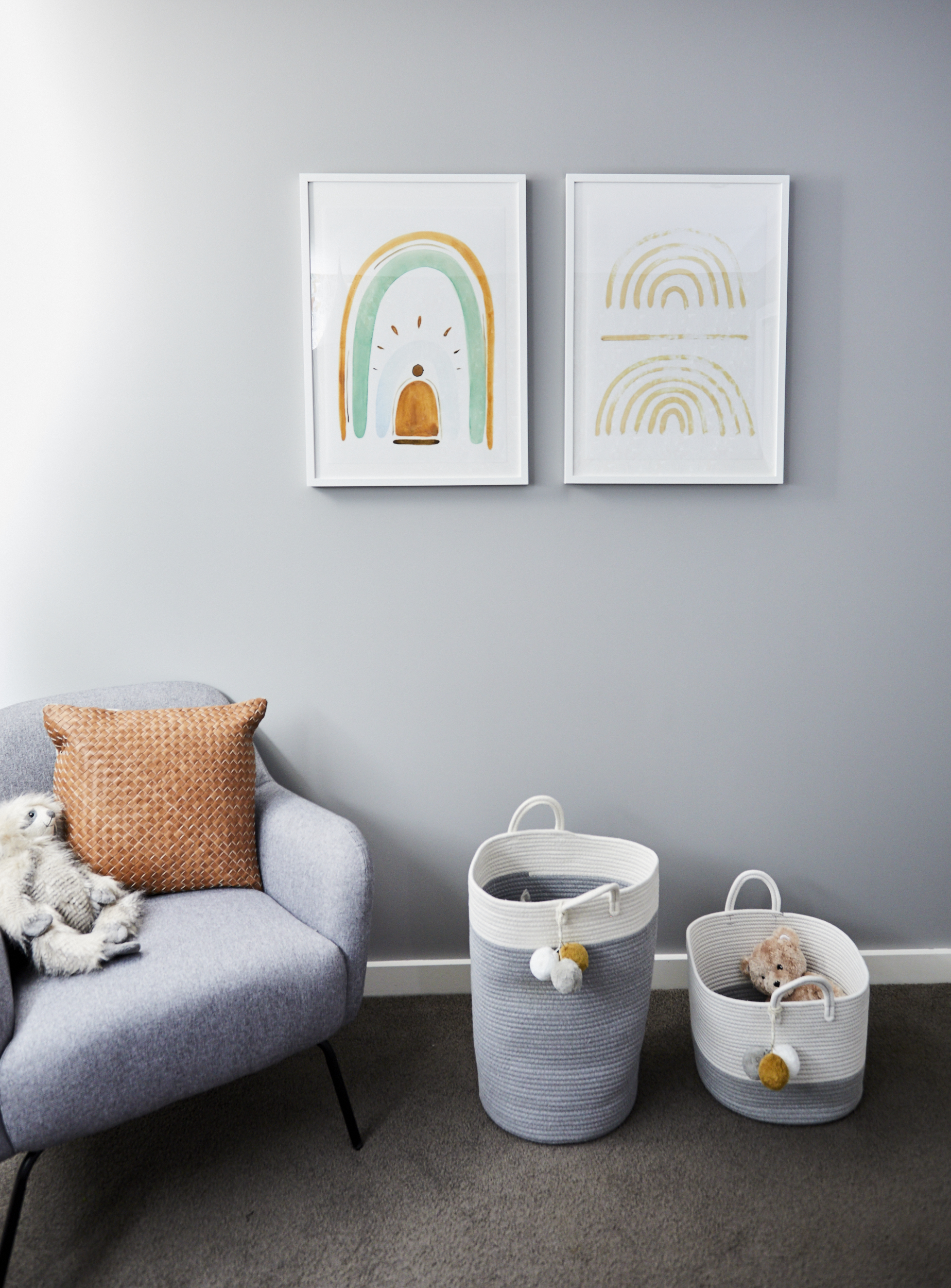 baby nursery_homeroom studio reveal_ grey and neutral armchair ad baskets