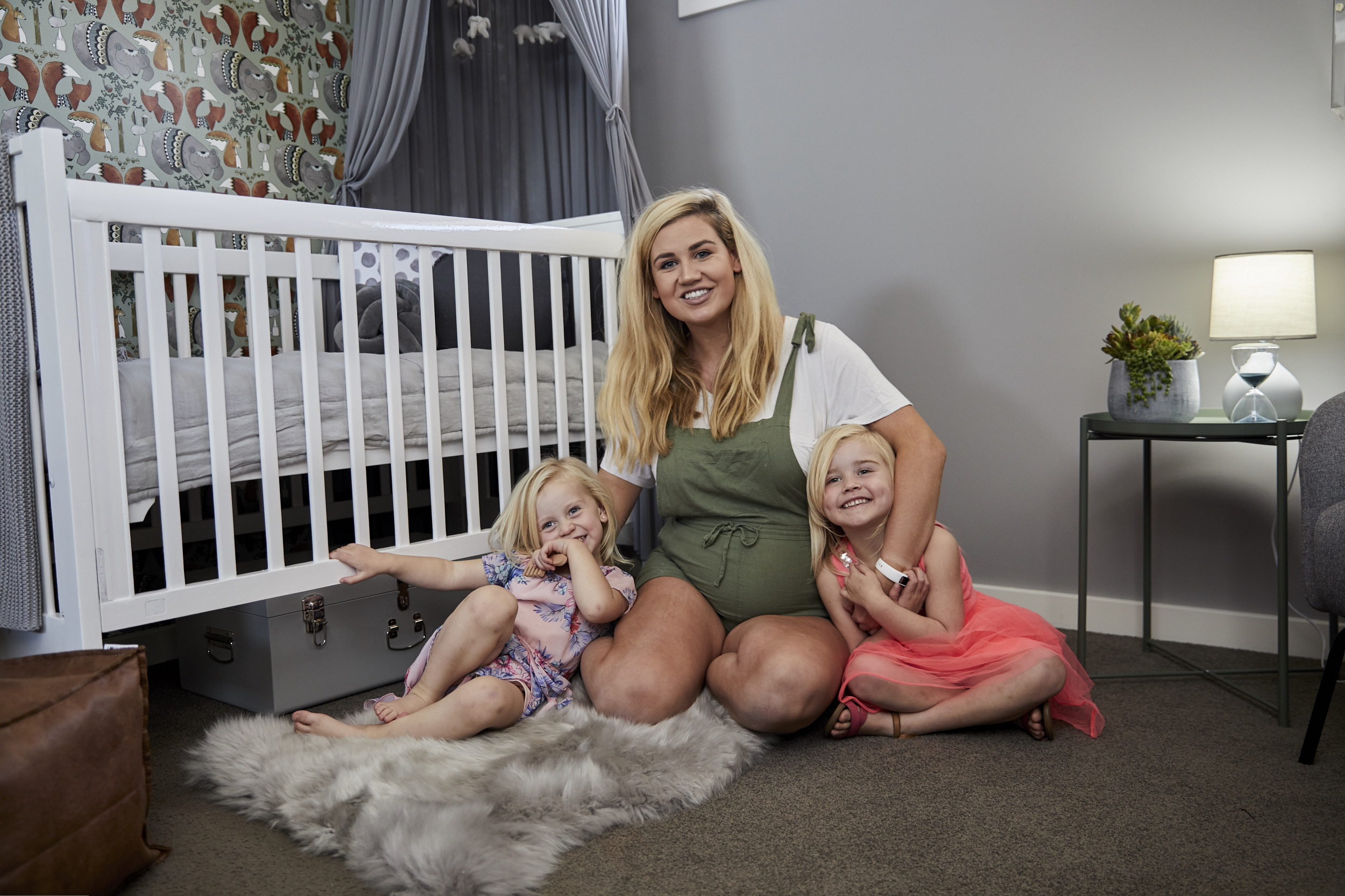Abby Gilmore and daughters at their baby nursery room reveal