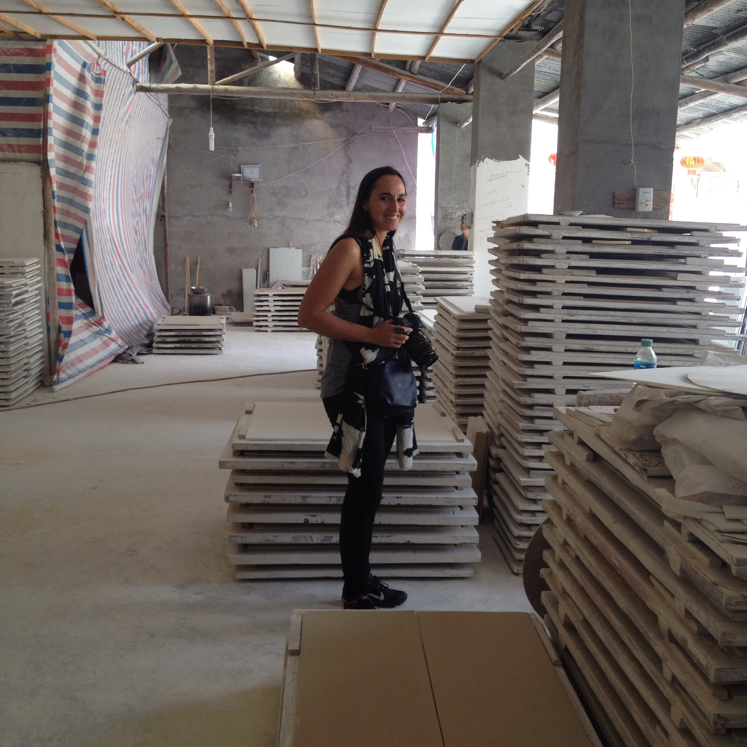 Artist Charlotte Cornaton in the big tile factory.