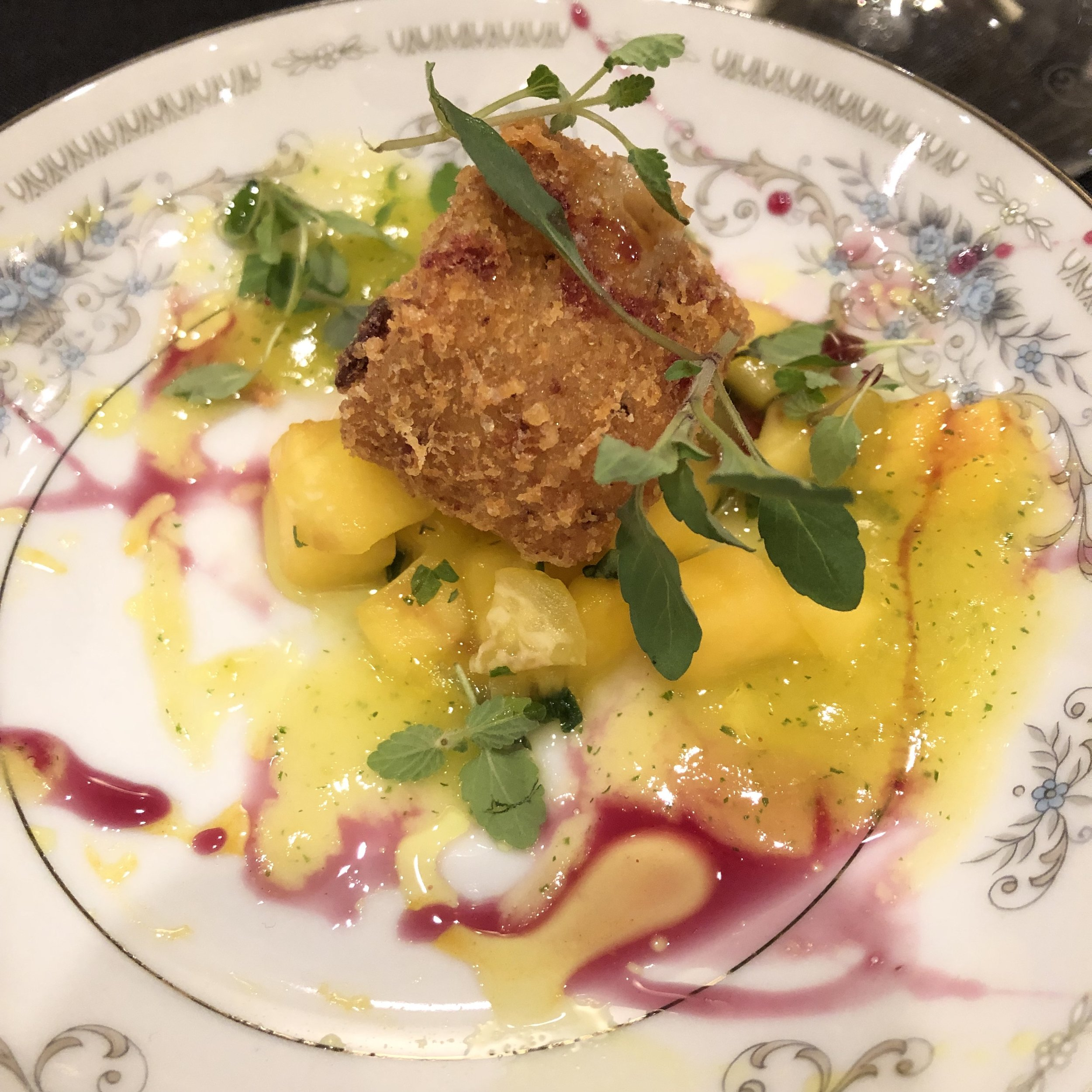 Amuse-bouche of crispy brie with mango mint salsa.