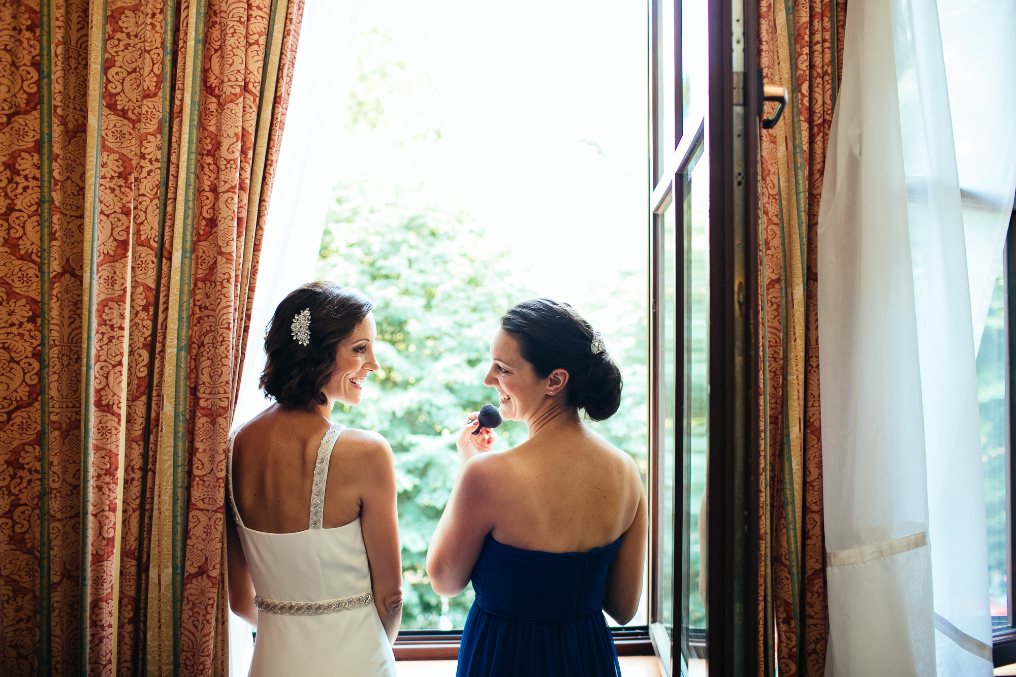 bride and sister emotional wedding photography