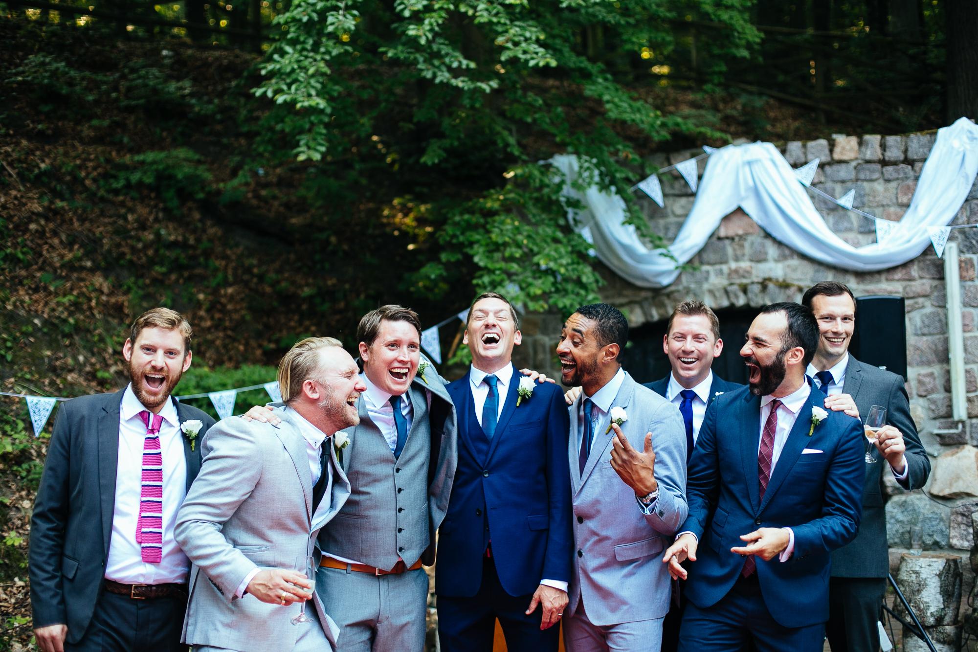 groom groomsmen ushers laughing group photograph destination wedding photography