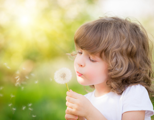 photodune-6945036-happy-child-blowing-dandelion-xs.jpg
