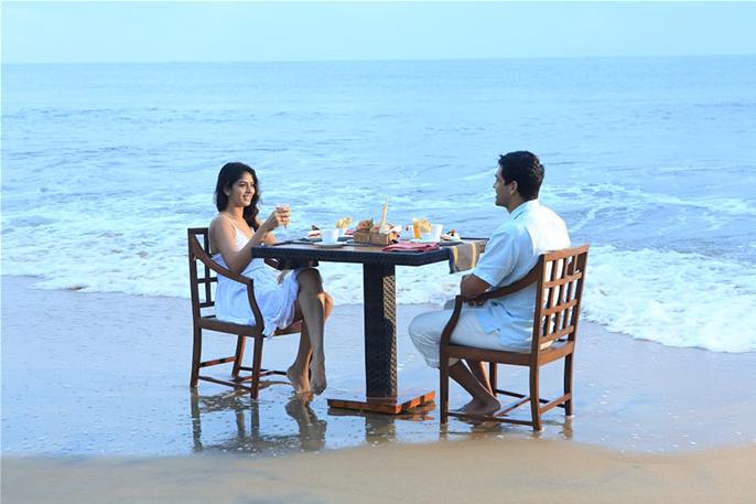 invite-to-paradise-sri-lanka-holiday-honeymoon-vacation-specialists -airport-hotel-negombo-beach-sea-dining on beach.png